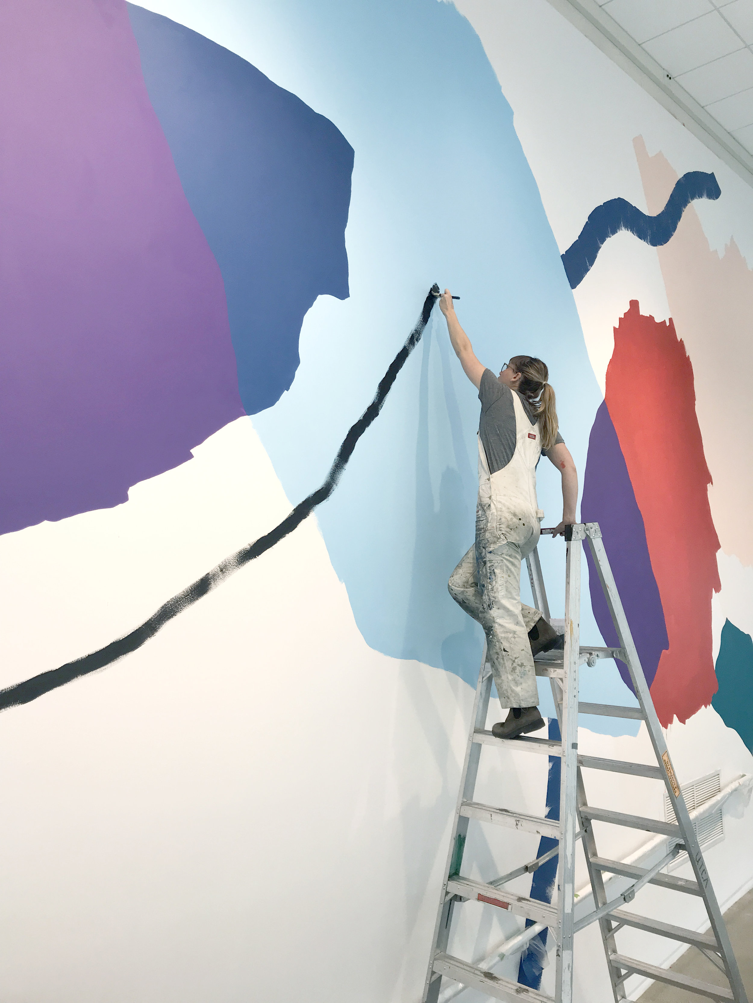 Heather Day paints her mural celebrating Pantone Color of the Year - Ultraviolet at the Urban Institute of Contemporary Art