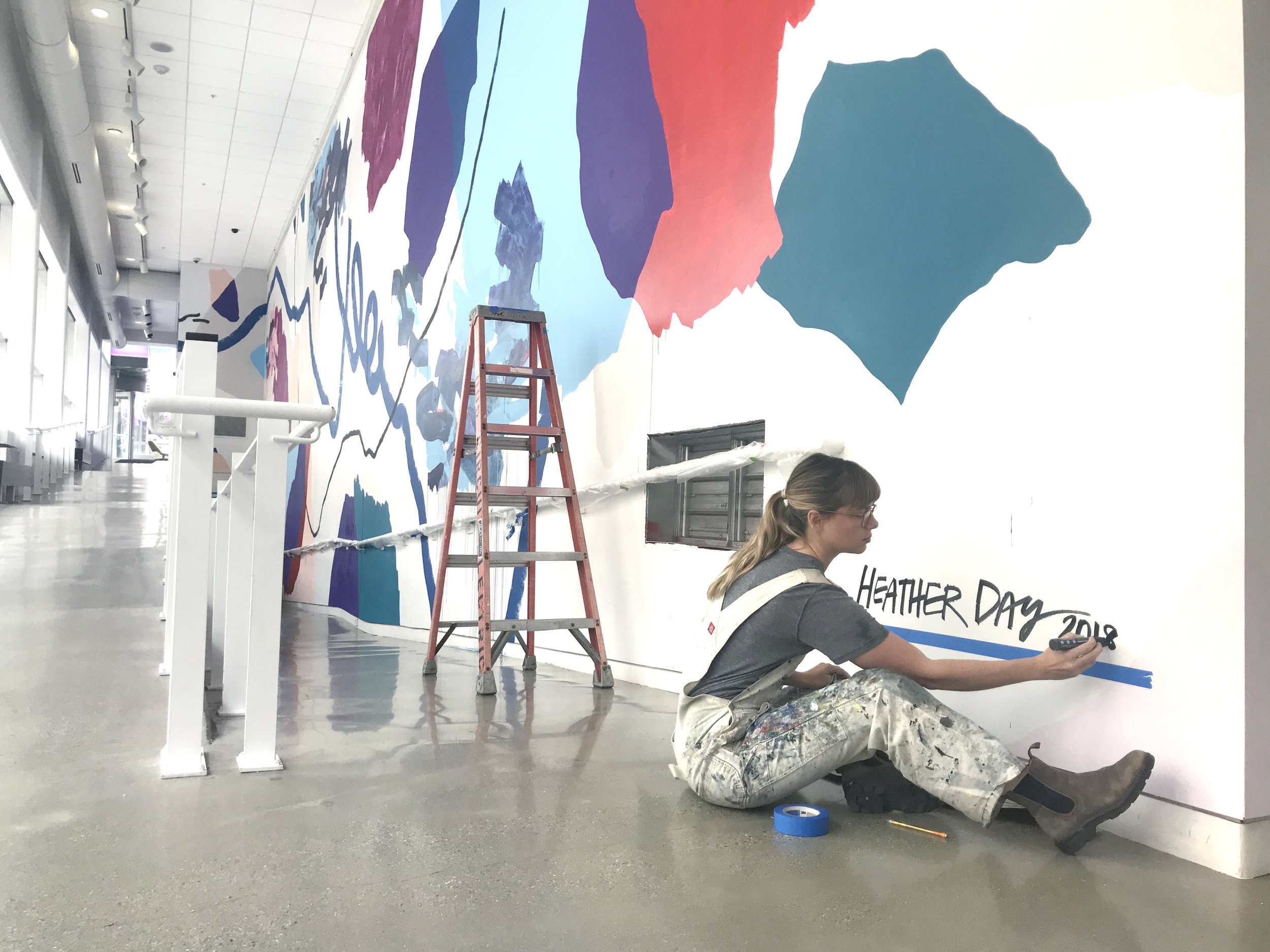 Heather Day signs UICA's Pantone Color of the Year mural