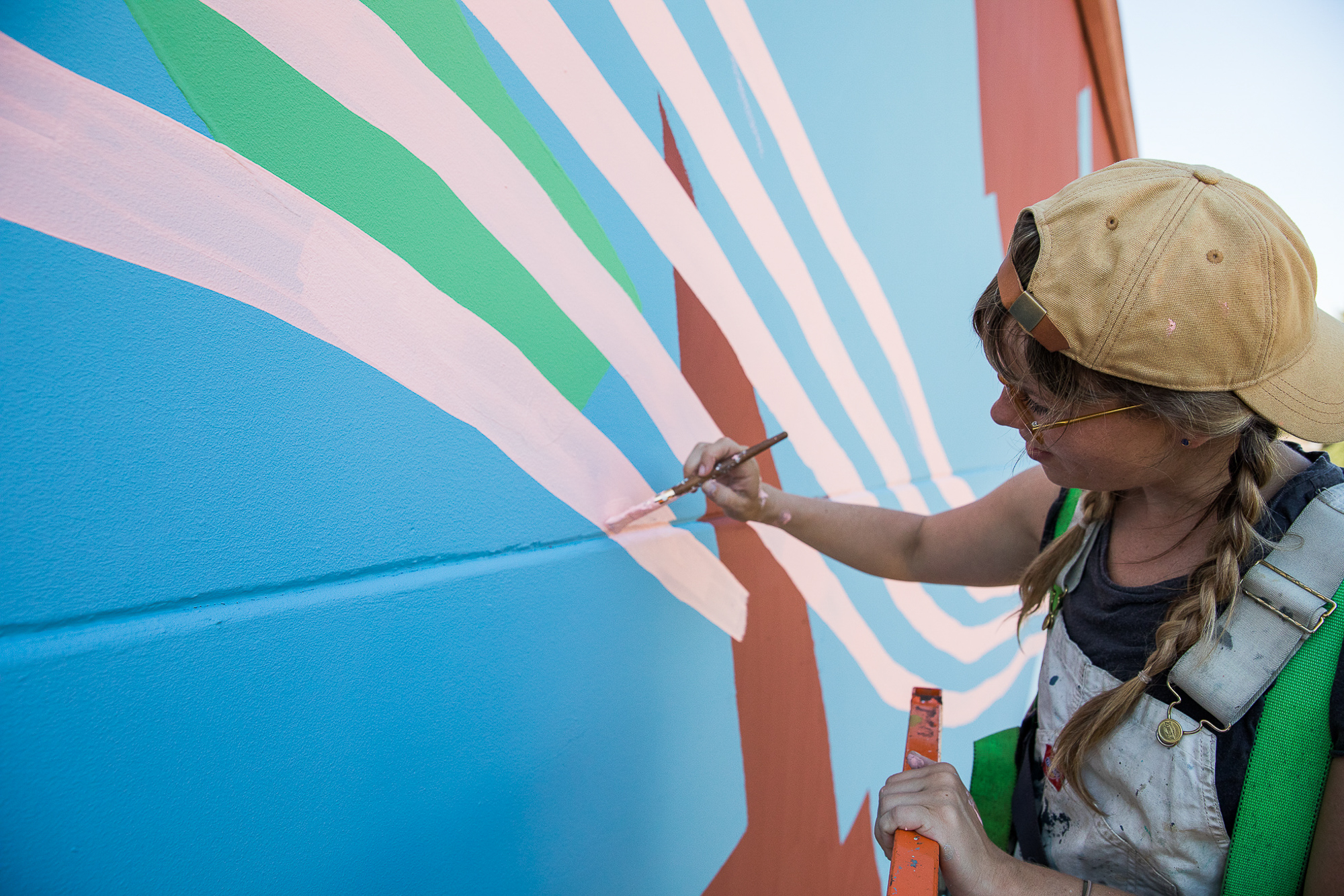 Heather Day makes final touches on her mural at Provenance Vineyards in Napa Valley