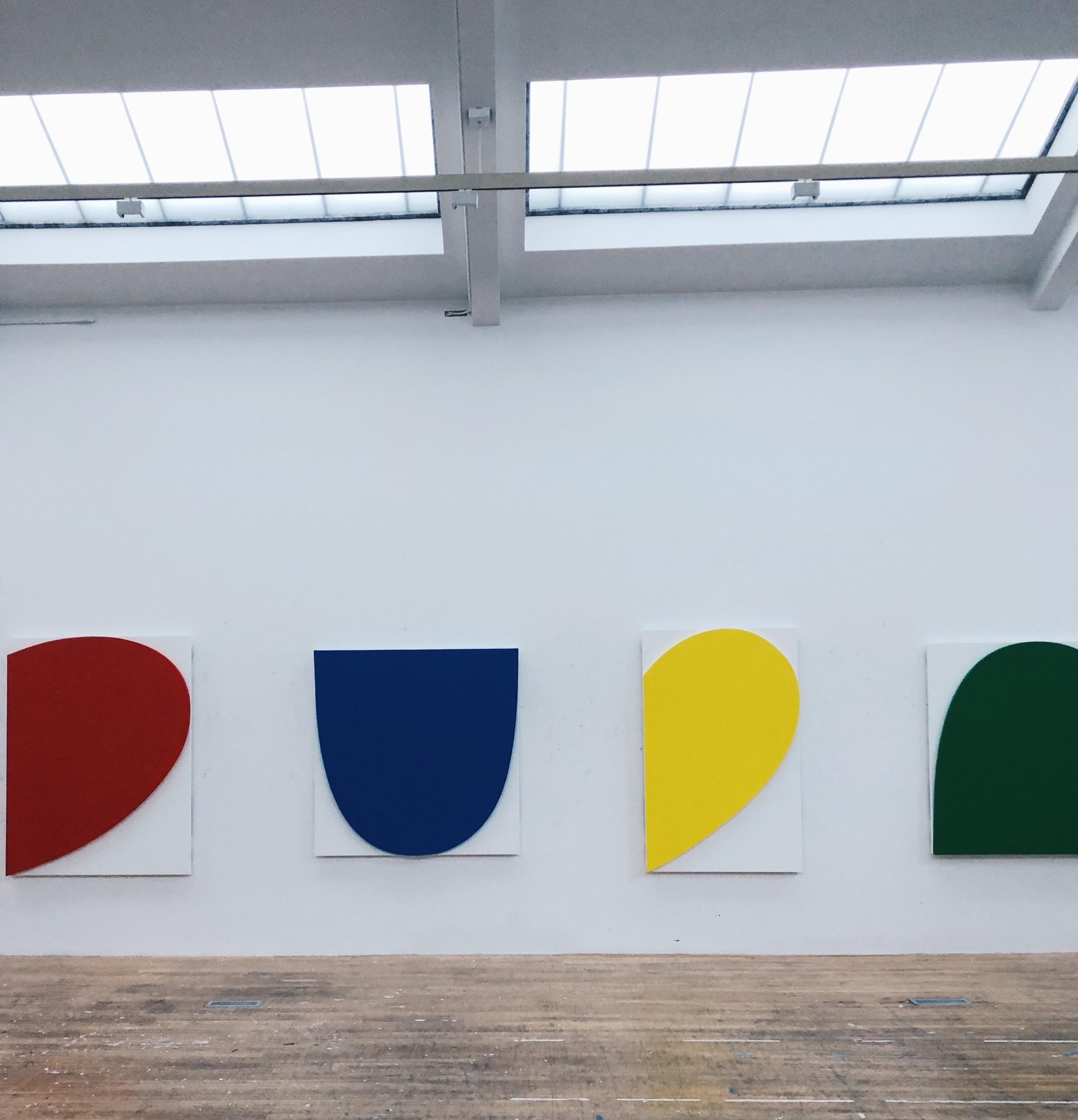 One half of Ellsworth Kelly's studio wall displaying his  Curves on White  paintings in Spencertown, New York
