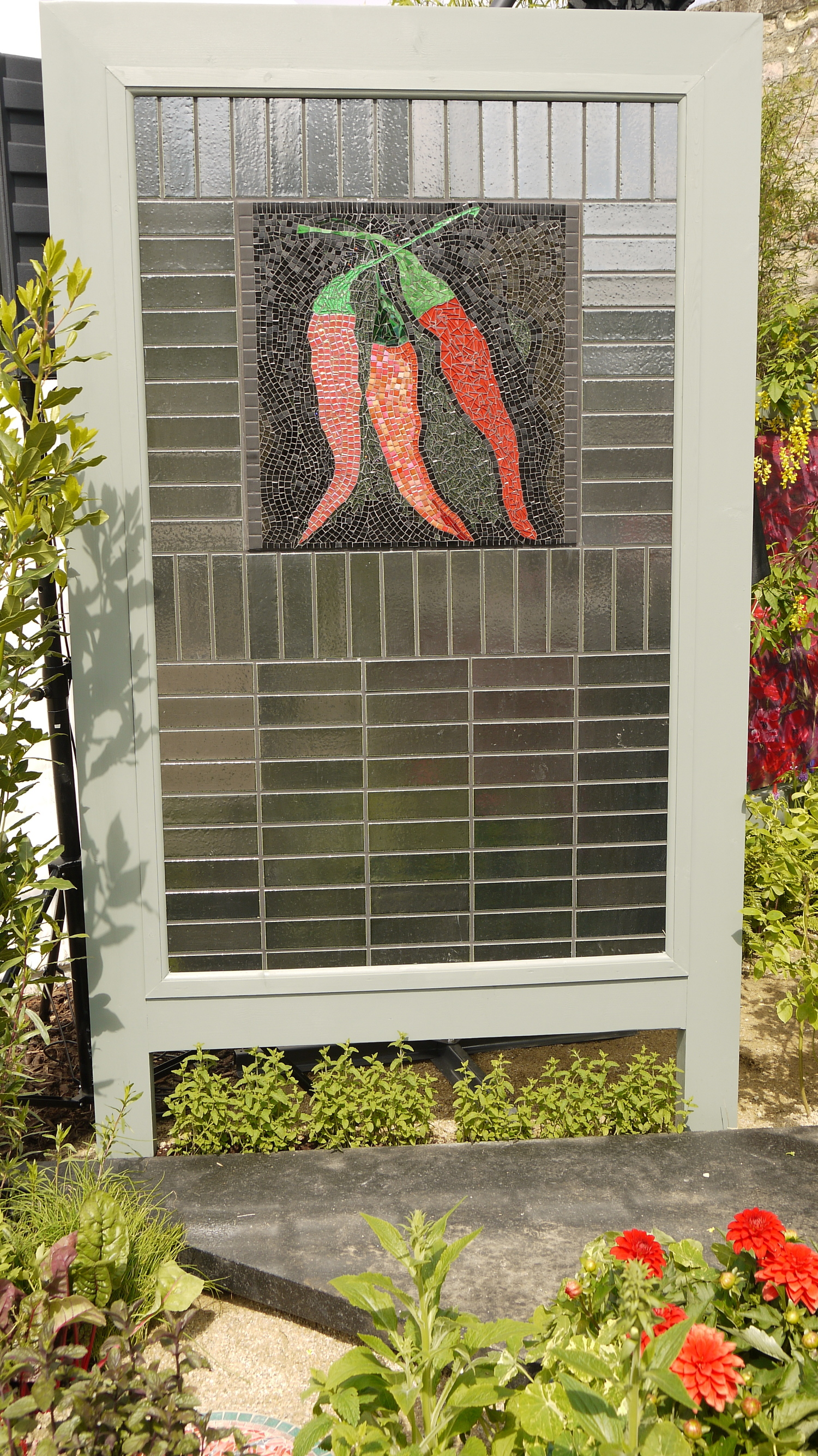 Red chilli mosaic by Dawn and framed with Fired Earth's Portland Lownsdale tiles