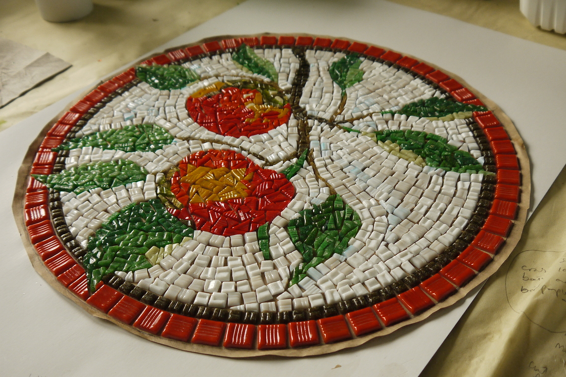 Apples mosaic ready for transference onto base.