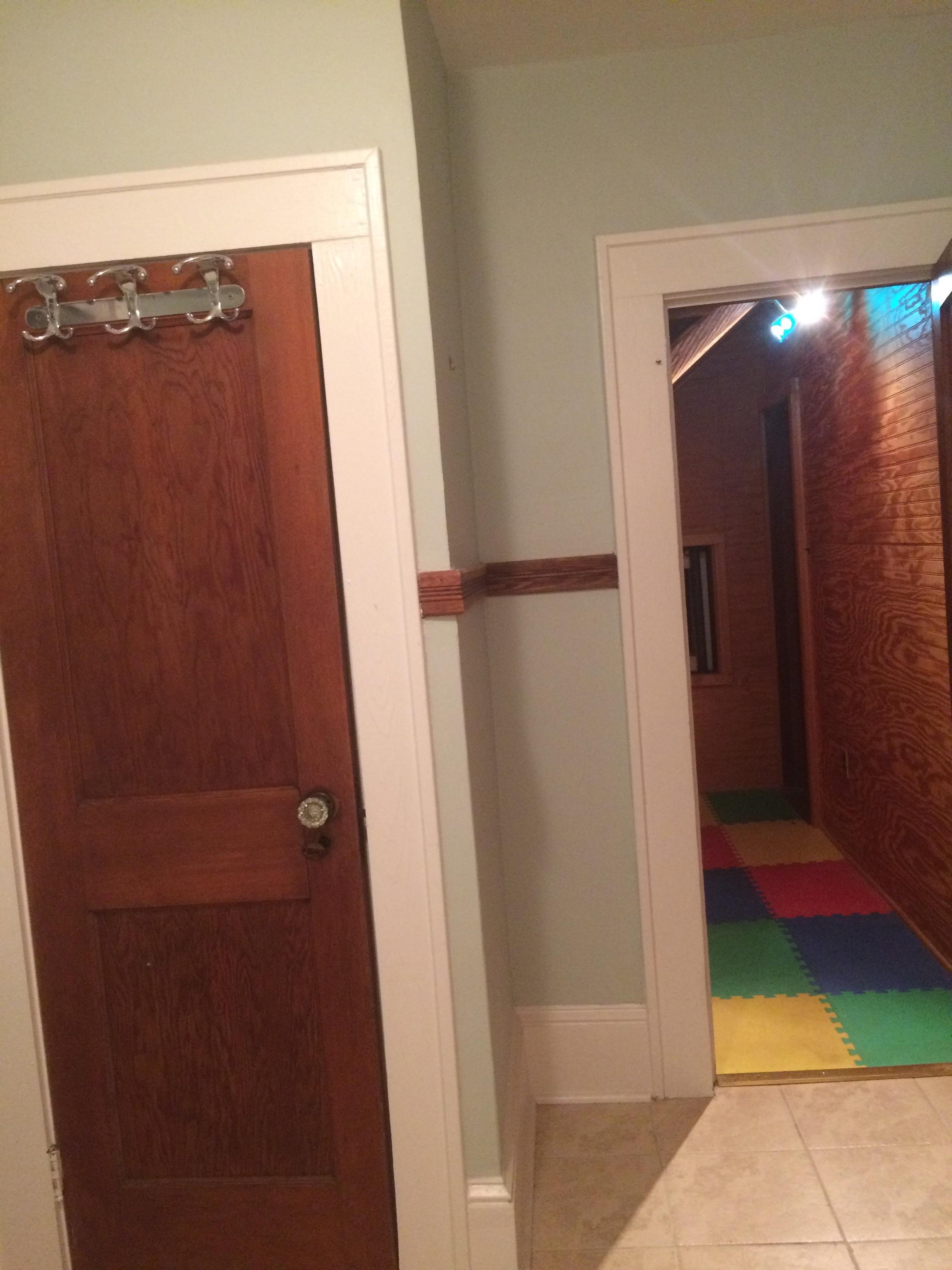 bathroom with linen closet door going into attic closet
