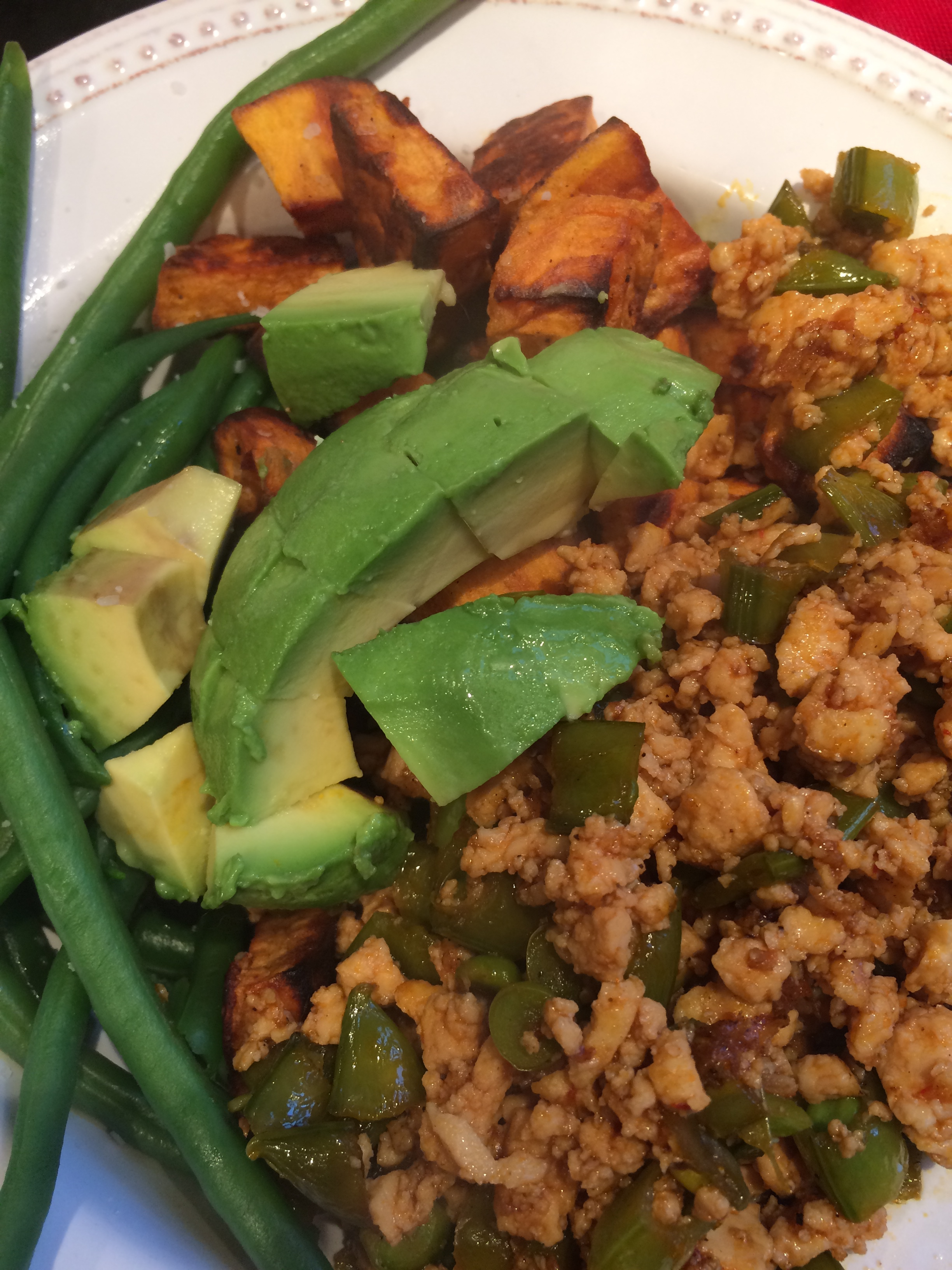 Spicy tofu with snap peas, with roasted sweet potatoes, avocado, green beans