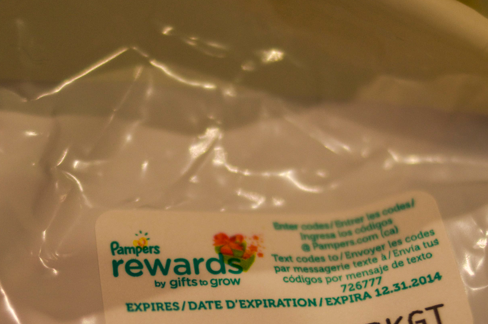 Pampers Rewards sticker with a code that you can enter into pampers.com