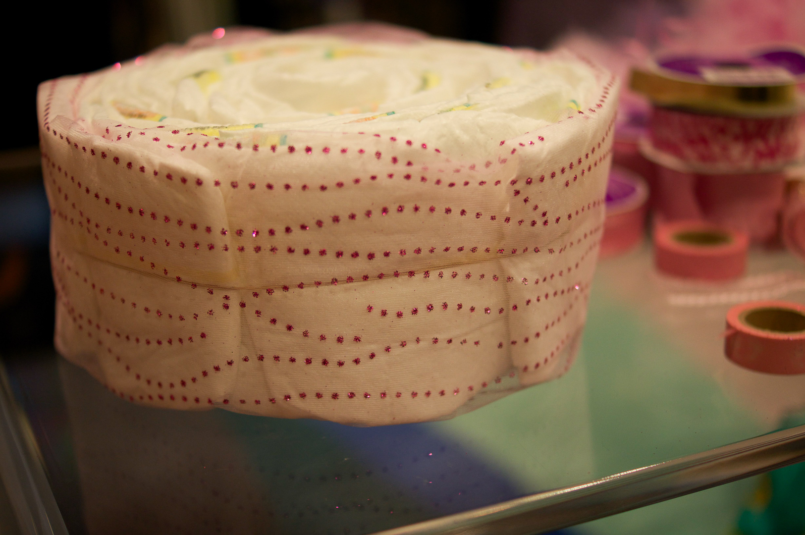 Mesh tulle wrapped around the diaper cake. I kept the rubber band in place.