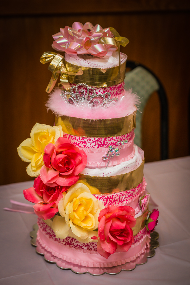 This is a four-tiered diaper cake that I made for my friend's baby shower. She used it again for her second baby shower.