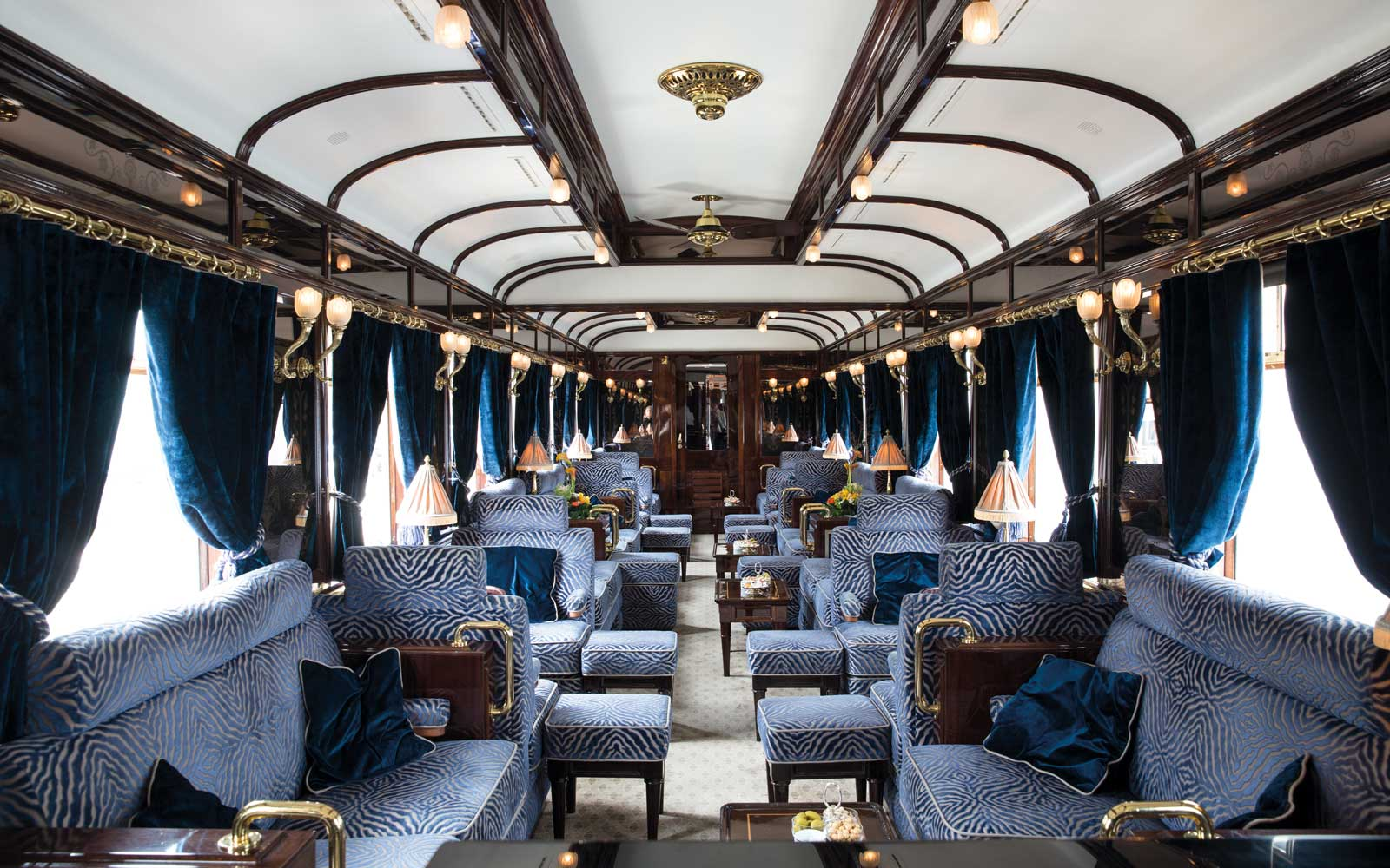 3674 - Named after the original number given to the carriage, the bar cart interiors are decorated in a timeless glamour featuring vibrant blue and gold detailing, reflecting the history of the train. This is the perfect place to enjoy an elegant evening with friends.