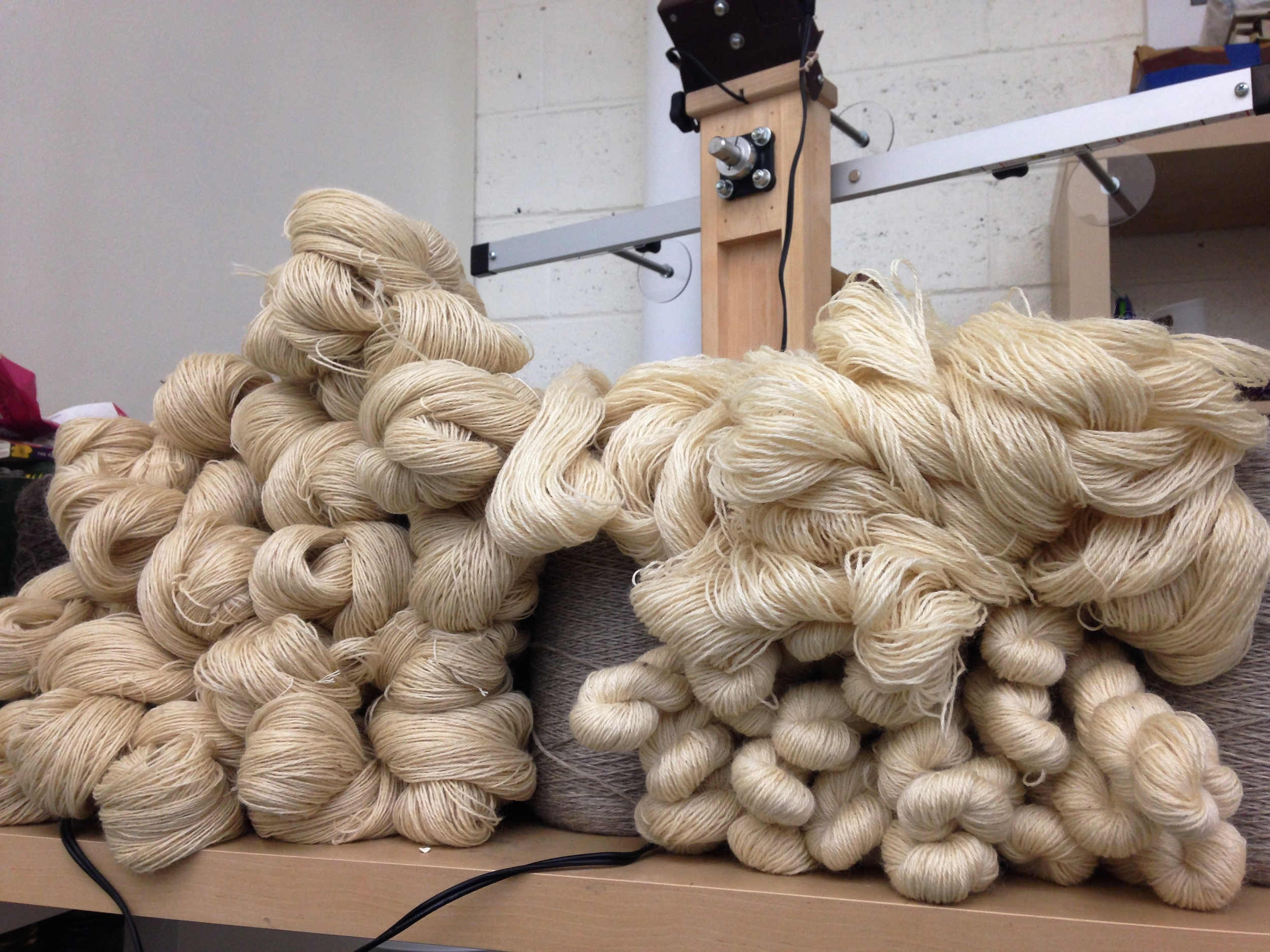 Yarn comes from the mill on cones - therefore the first step of dyeing is skeining, and skeining, and skeining, and then building a fort with all of the piles of skeined yarn.