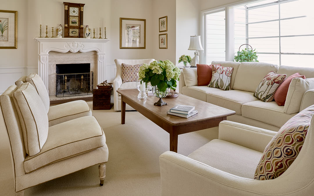 Elegant living room in the Russian Hill neighborhood of San Francisco, CA showing seating and fireplace illustrating expected results of hourly rate photography. Photographed by Dean Birinyi, interior photographer in San Francisco, CA.