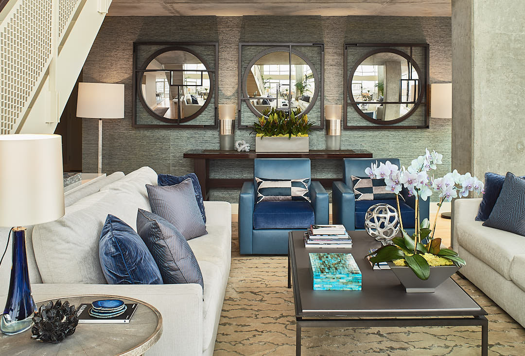 One point perspective view of Contemporary living room in South Beach neighborhood of San Francisco, CA showing seating a convex mirrors. Used to illustrate the expected results of using supplemental lighting to photograph interiors  Photographed by Dean Birinyi, interior photographer in San Francisco, CA.