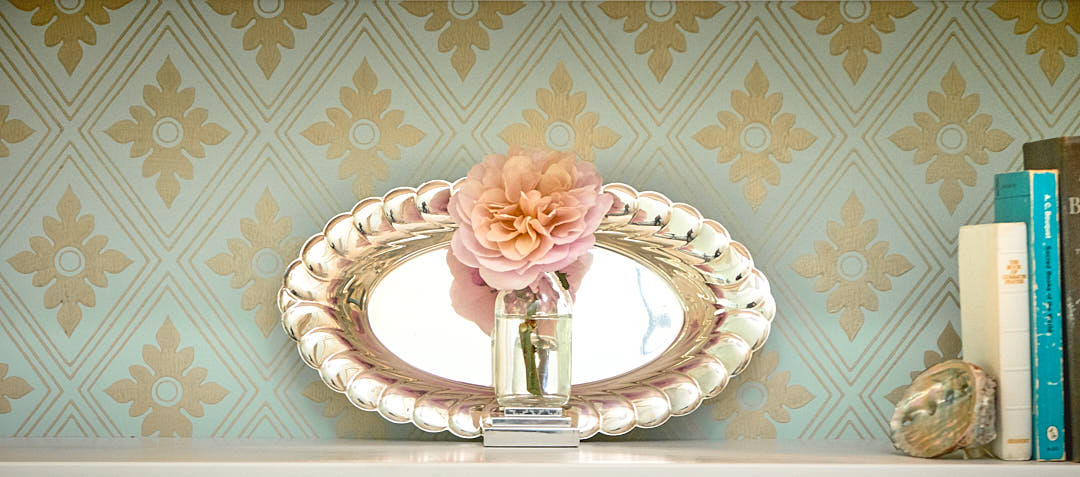 Close-up of a Rose, silver tray and foil wallpaper in Lafayette, CA.  Photographed by Dean Birinyi, interior photographer in San Francisco, CA.