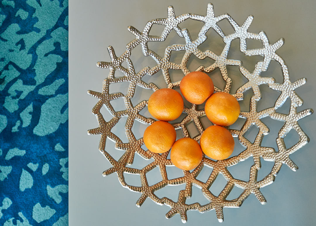 Abstract close up photograph of lacy fruit bowl with oranges in Newport Beach, CA.  Photographed by Dean Birinyi, interior photographer in San Francisco, CA.