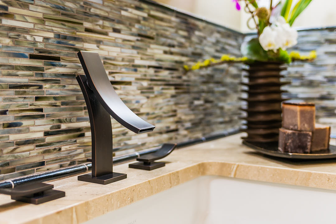 Bathroom faucet in stylish guest bathroom in Foster City, CA.  Photographed by Dean Birinyi, interior photographer in San Francisco, CA.