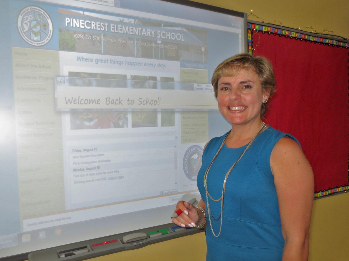 Pinecrest Elementary Principal Marisol Diaz at interactive smartboard