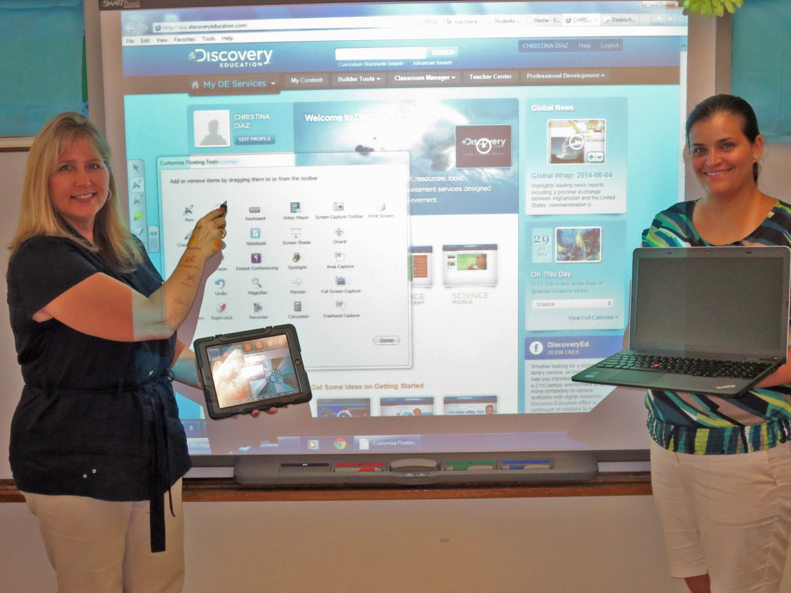 Howard Drive Principal Deanna Dalby & Asst. Principal Christina V. Diaz show off smartboard, iPad and laptop tech