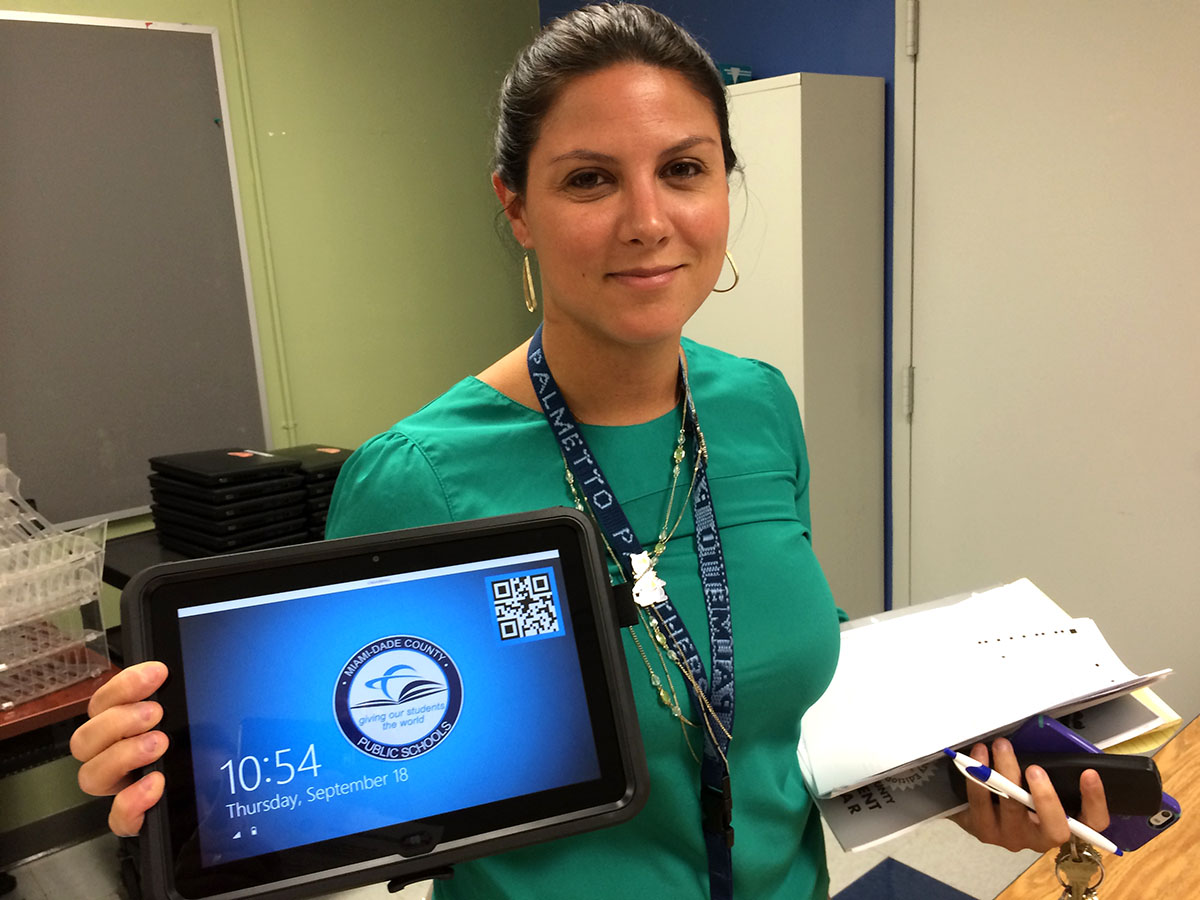 Assistant Principal Karina Menendez shows off the new tablets available to 9th graders