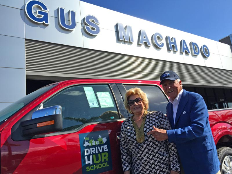 Lilliam and Gus Machado show off a new Ford