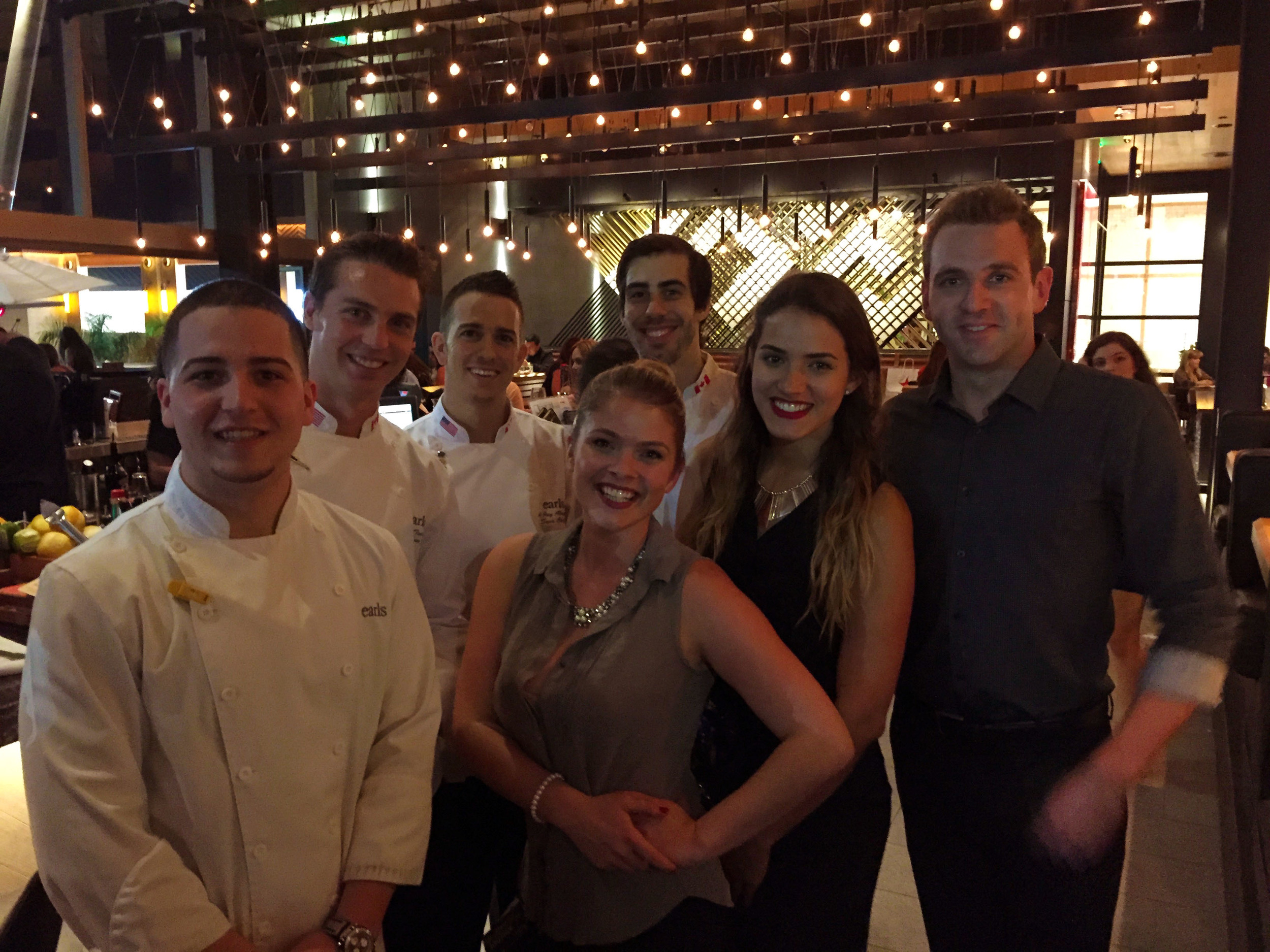 From center: Emily Scott, our server Diana  and Andrew Goldsmith (and some of the chefs)