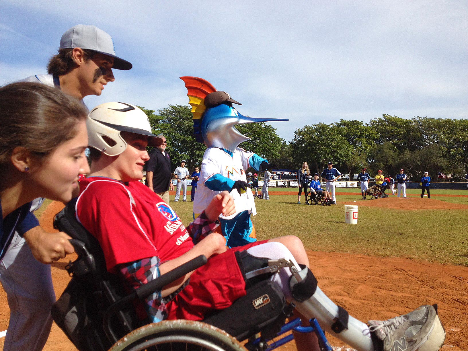 Cameron Honey gets a hit as Billy the Marlin cheers him on in the Miracle League game.
