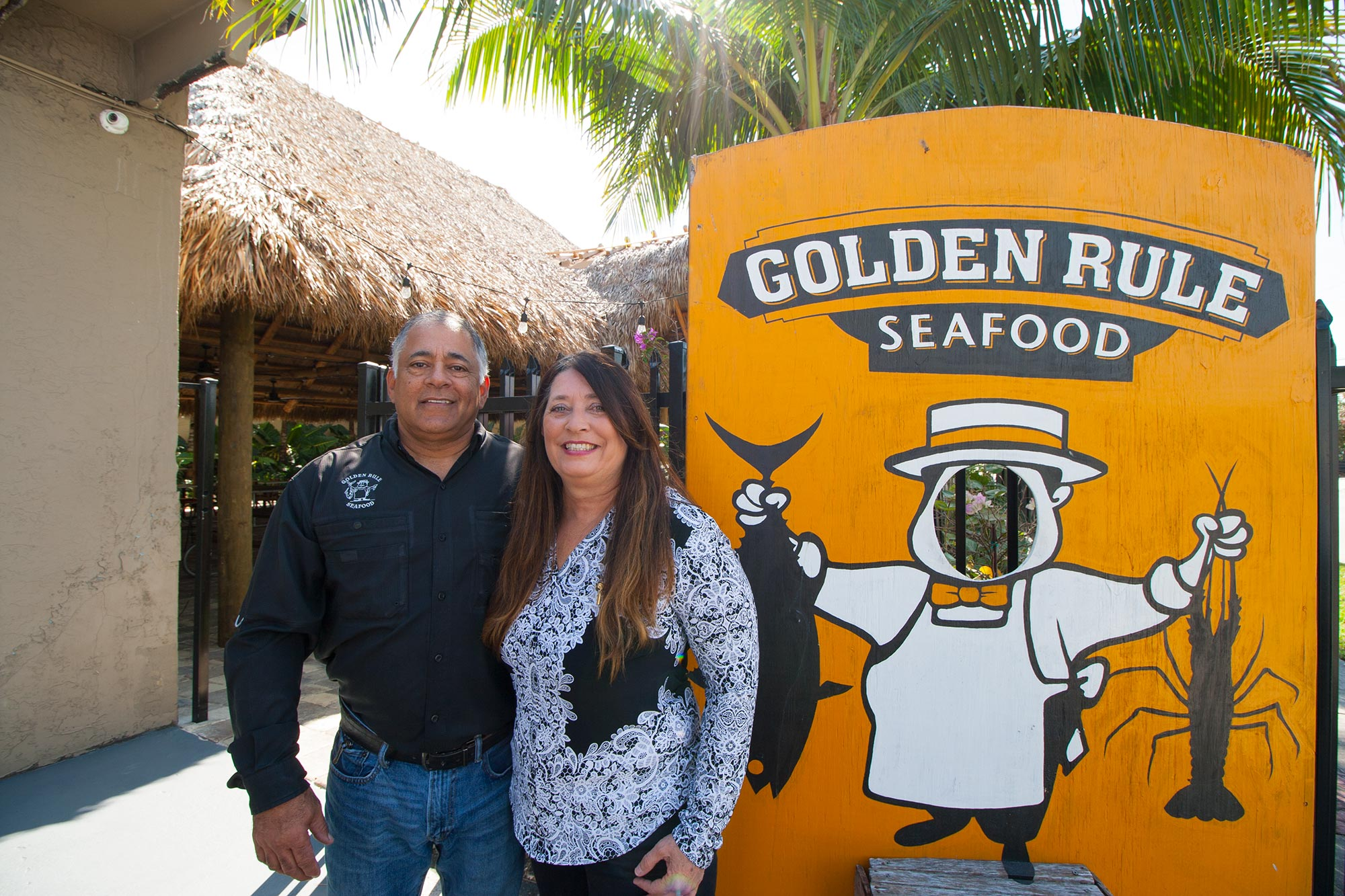 Husband Walter Flores and wife Pamela Mullins outside their new outdoor restaurant space