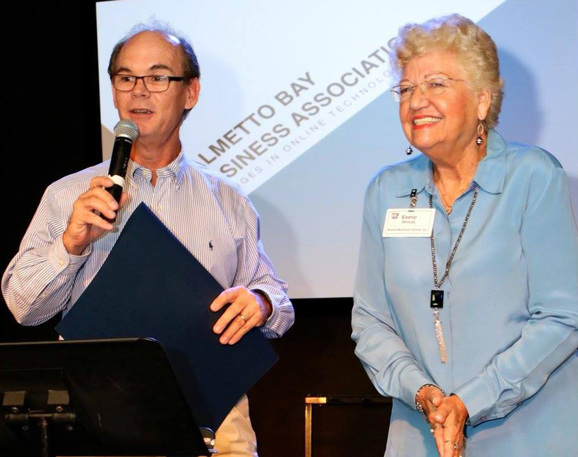 Mayor Flinn provides Winhold with proclamation for her work (January 2016)