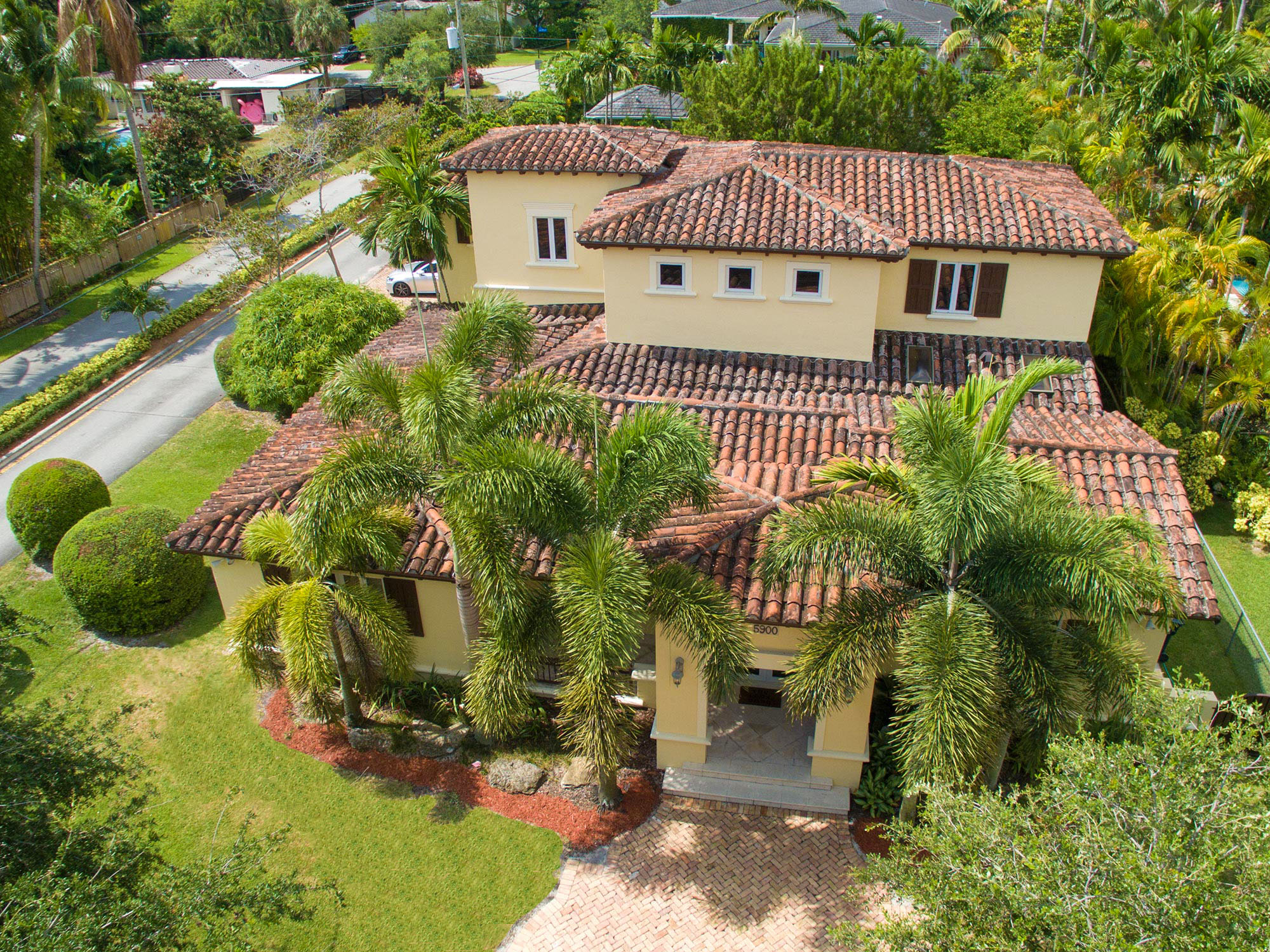 MiamiHal, top agent in South Miami, takes his drone up for a lofty photo of this wonderful estate.