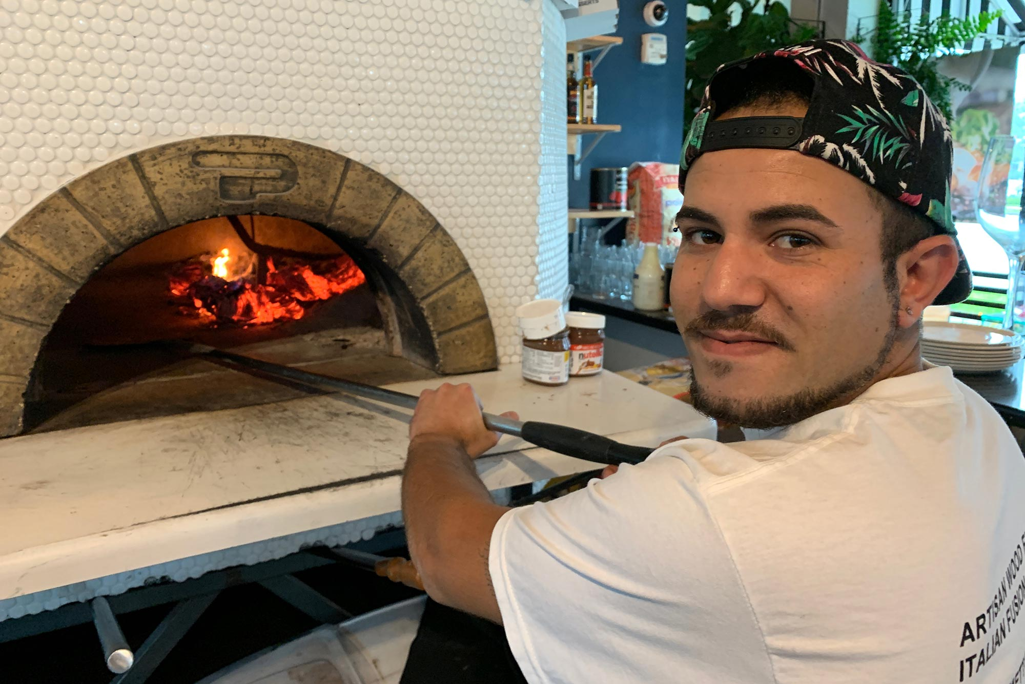 Pasquale gets things heated up in the wood-fired oven