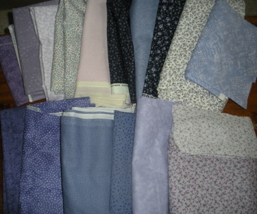 SAMPLE RANGE OF BLUE COLOR FABRICS FOR A CUSTOM QUILT