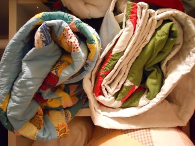 STORE QUILTS ROLLED UP LIKE SLEEPING BAGS IN COTTON PILLOW CASES