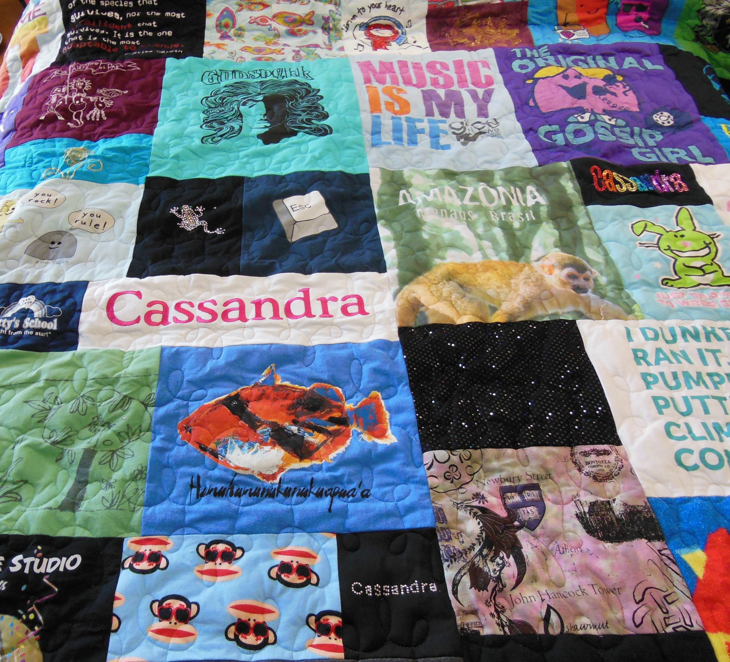 T-SHIRTS REPURPOSED INTO A REVERSIBLE QUILT