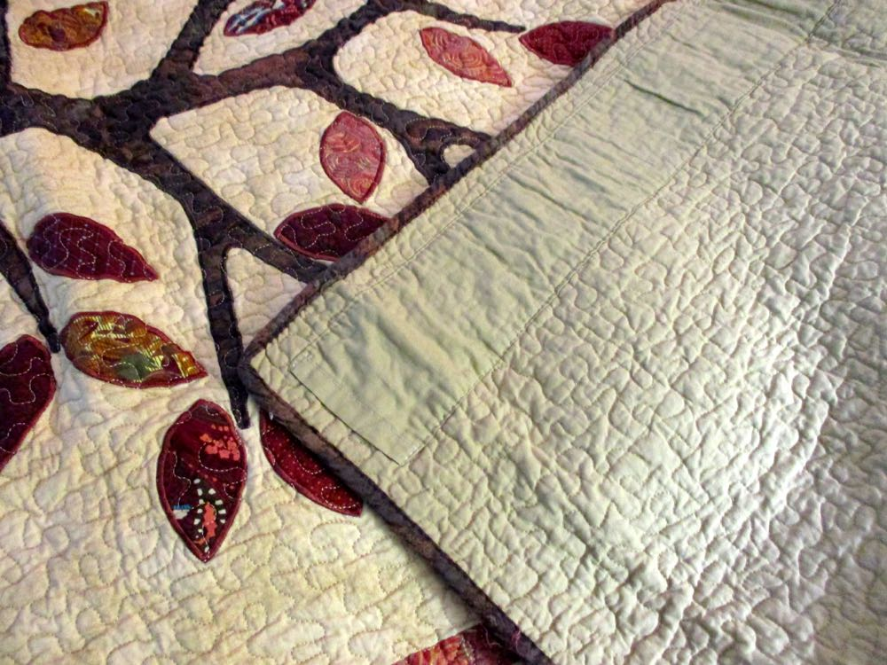 TREE OF LIFE LAP QUILT THROW WITH A HANGING SLEEVE ON BACK