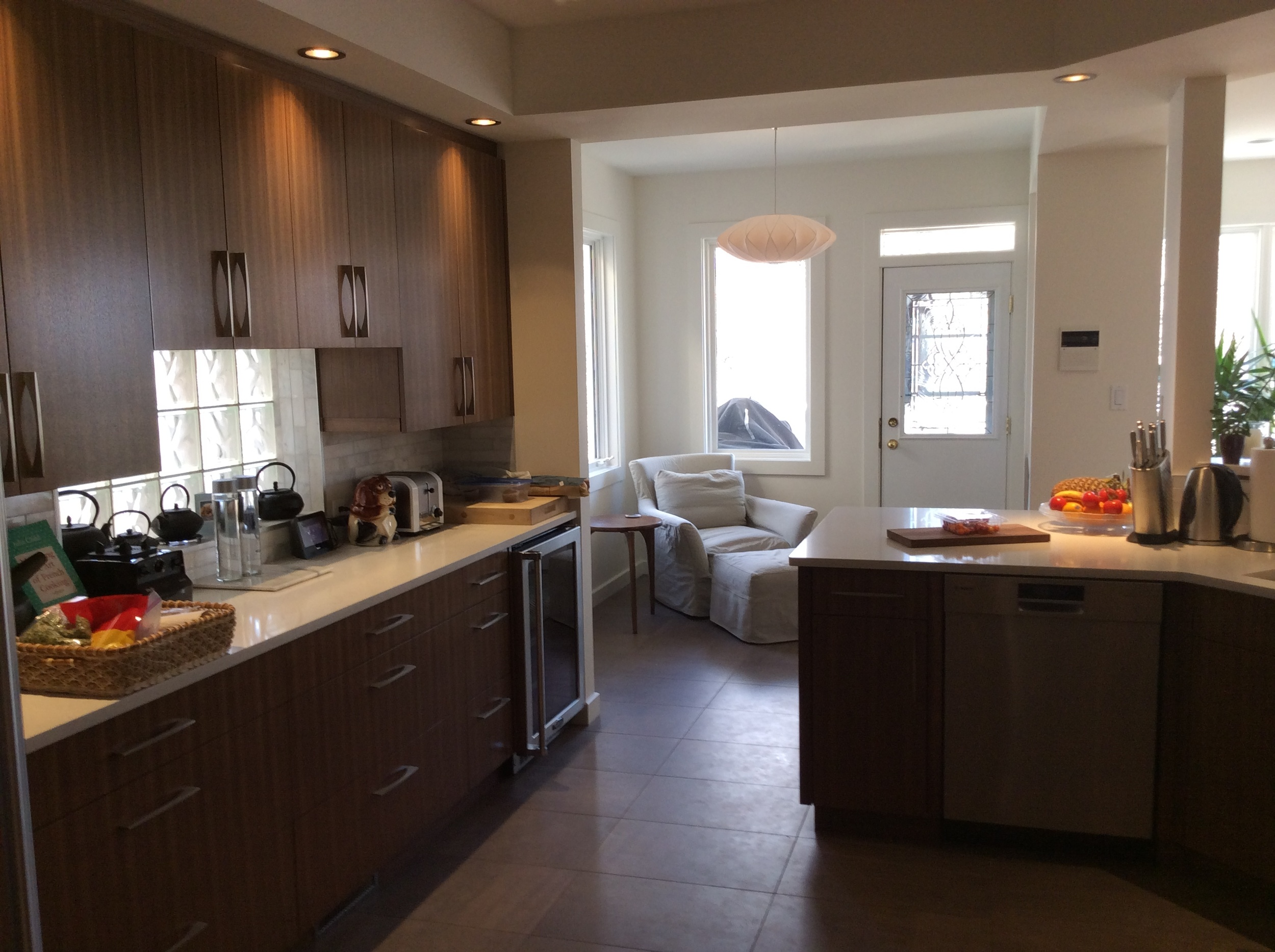Custom Walnut cabinets, quartz countertops, bianco carrara backsplash, George Nelson bubble lamp.