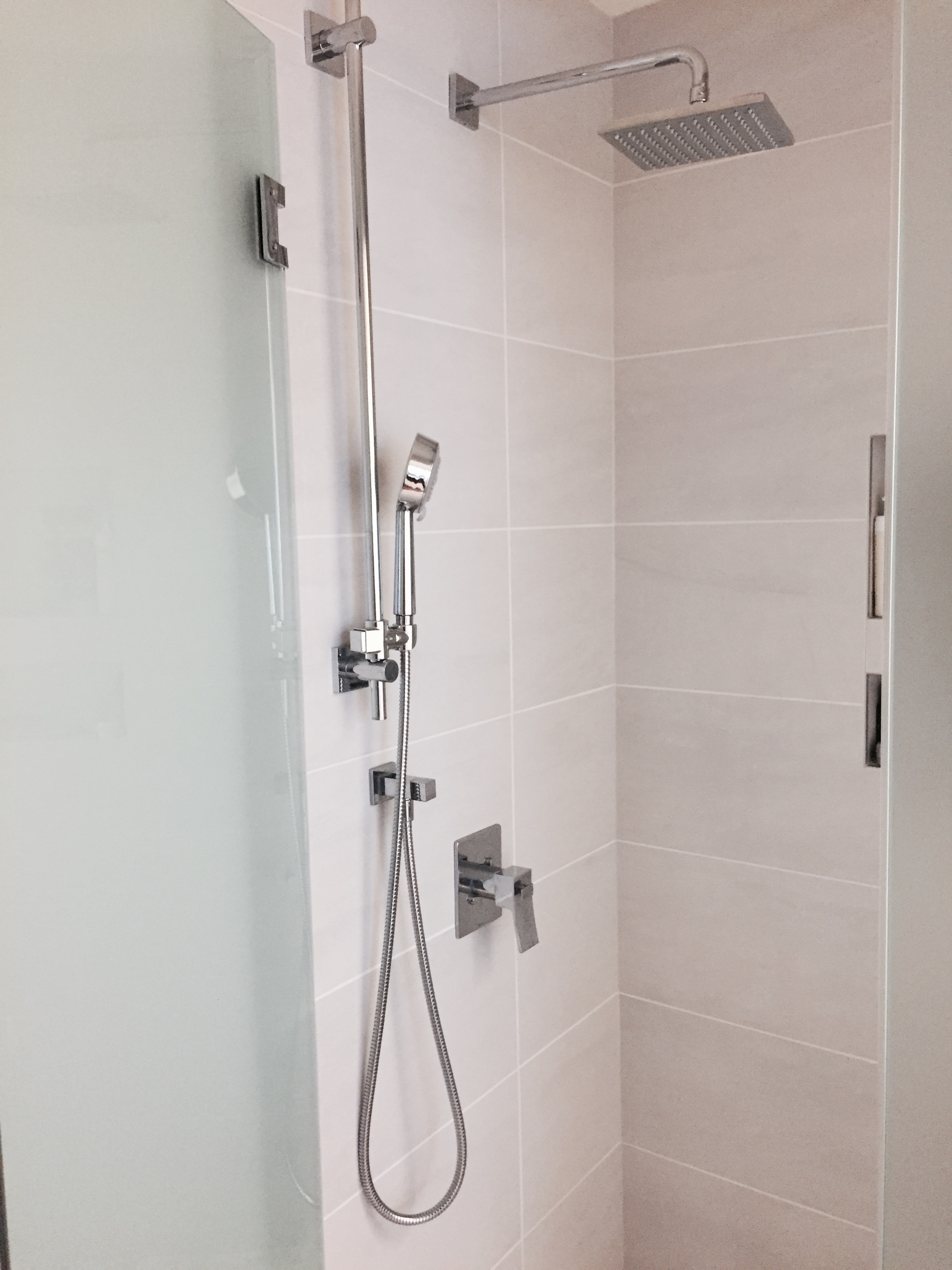 Custom shower, rain head and hand shower.