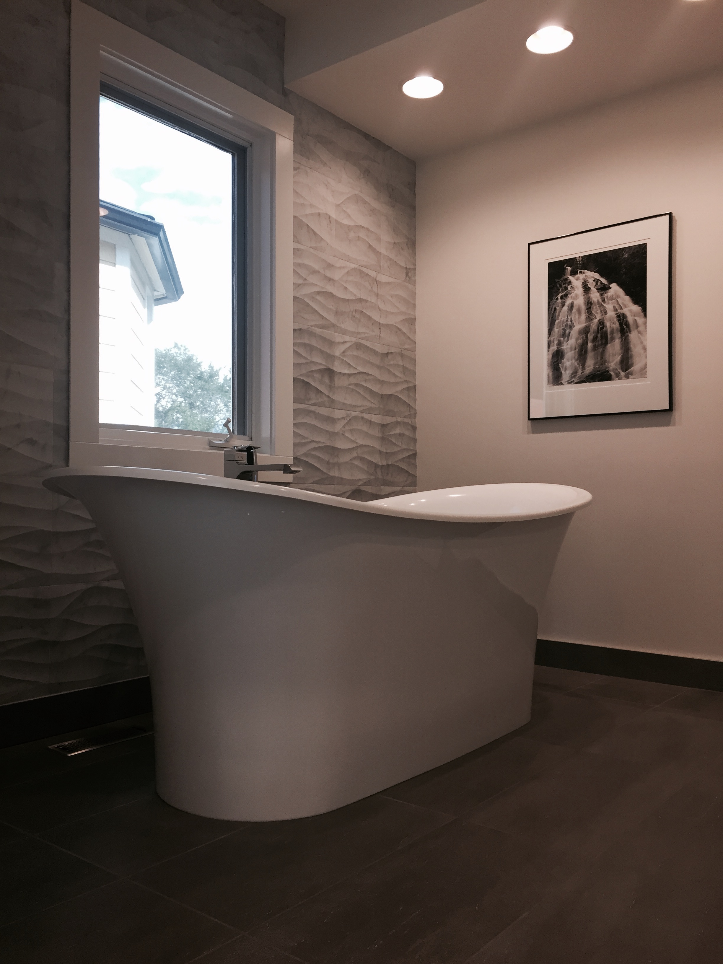 Volcanic limestone bathtub, Victoria and Albert. Ziva Leaves Artistic Tile.