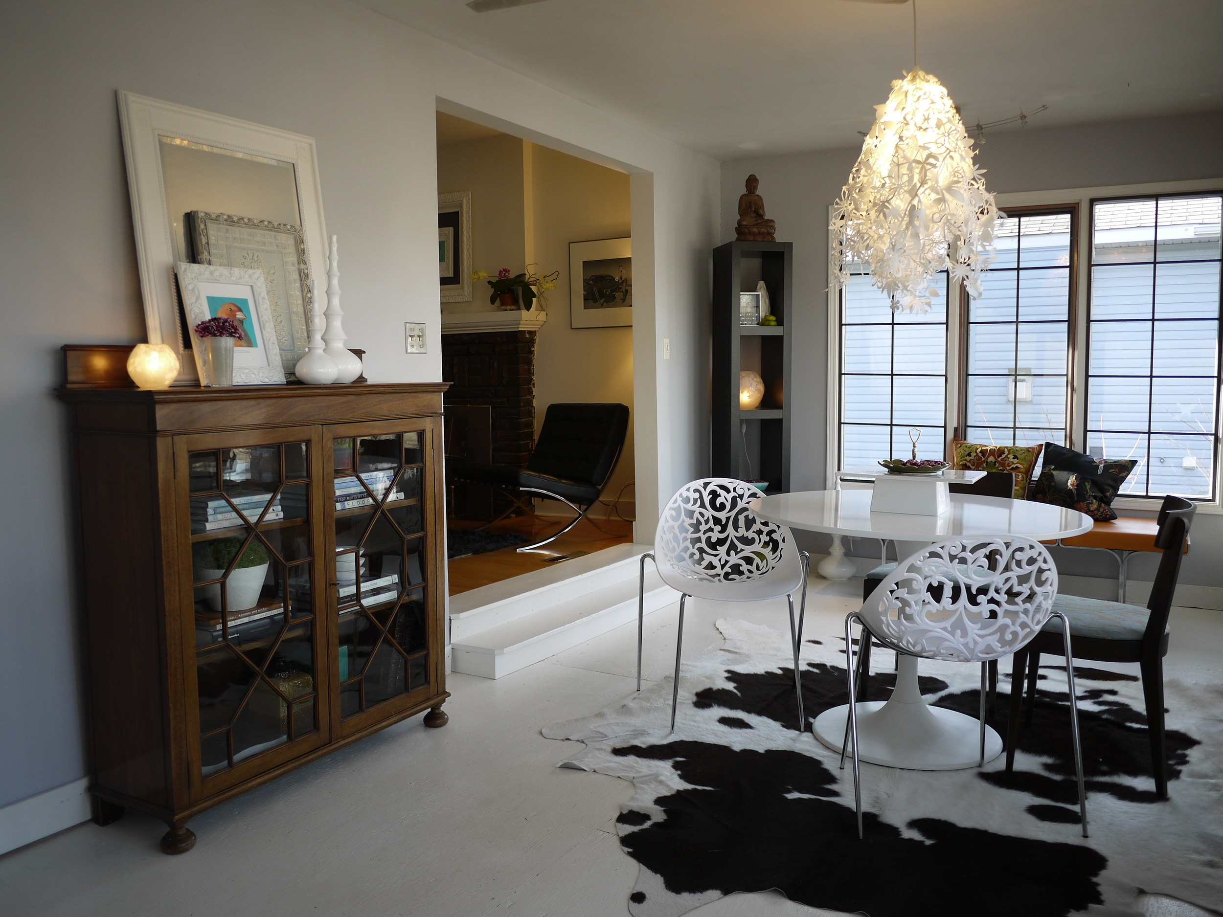 Midsummer Light Chandelier, tulip table, Kare dining chairs, cow hide rug and Chippendale bookcase.