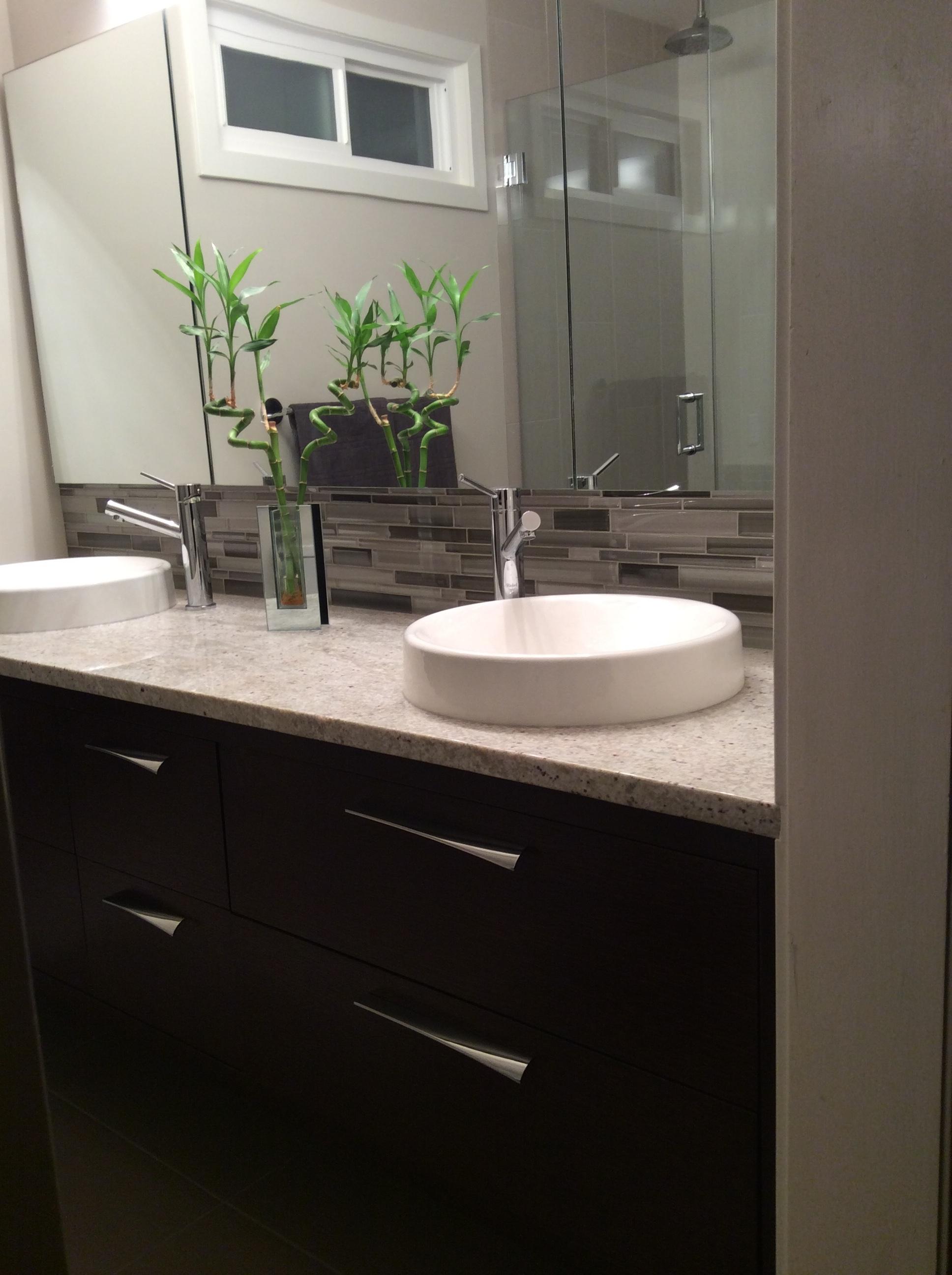 Custom quarter sawn oak cabinetry, granite countertops, round porcelain sinks, glass backsplash.