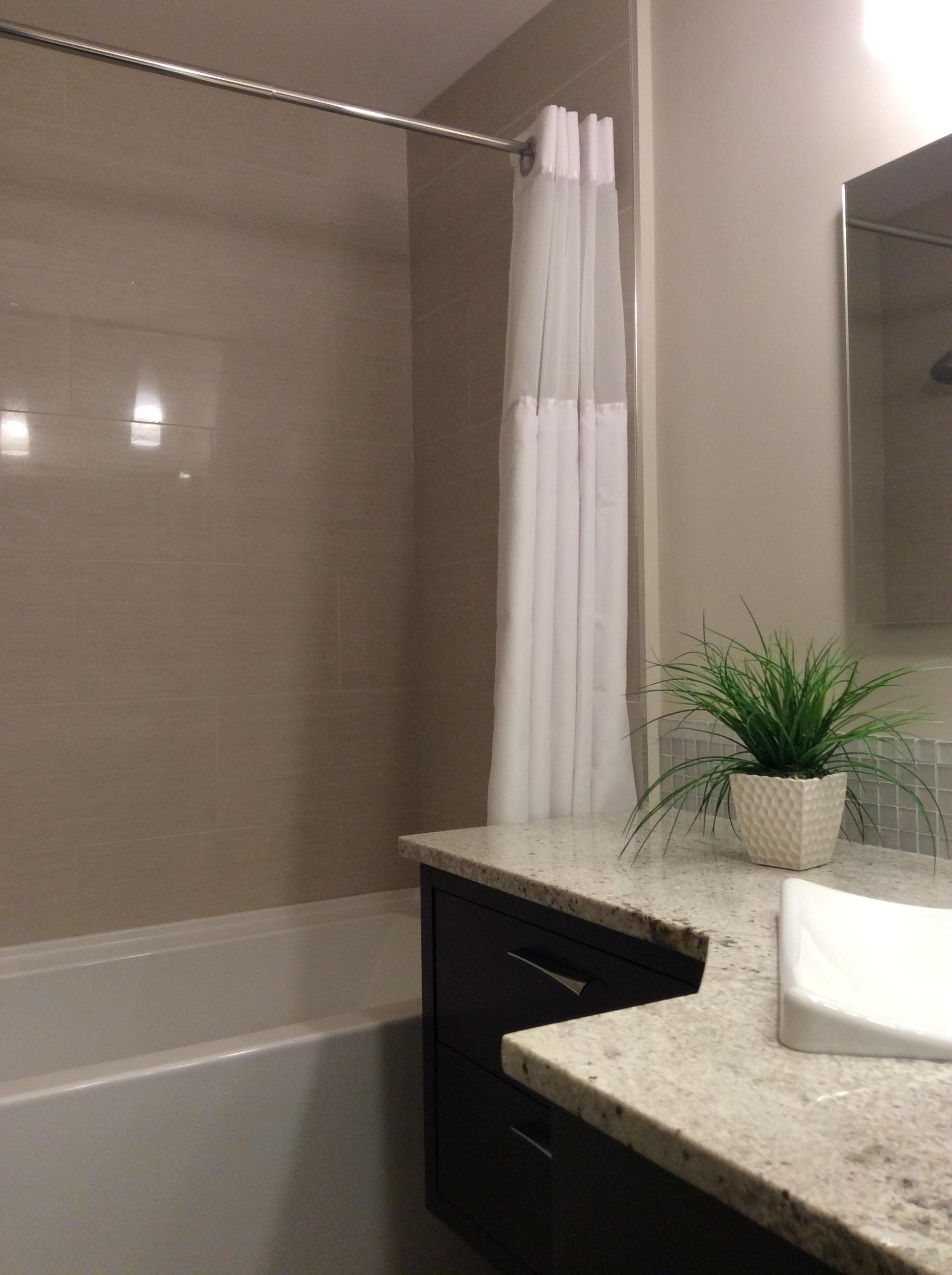 Custom cabinetry quarter sawn oak, granite countertops, porcelain tub surround.
