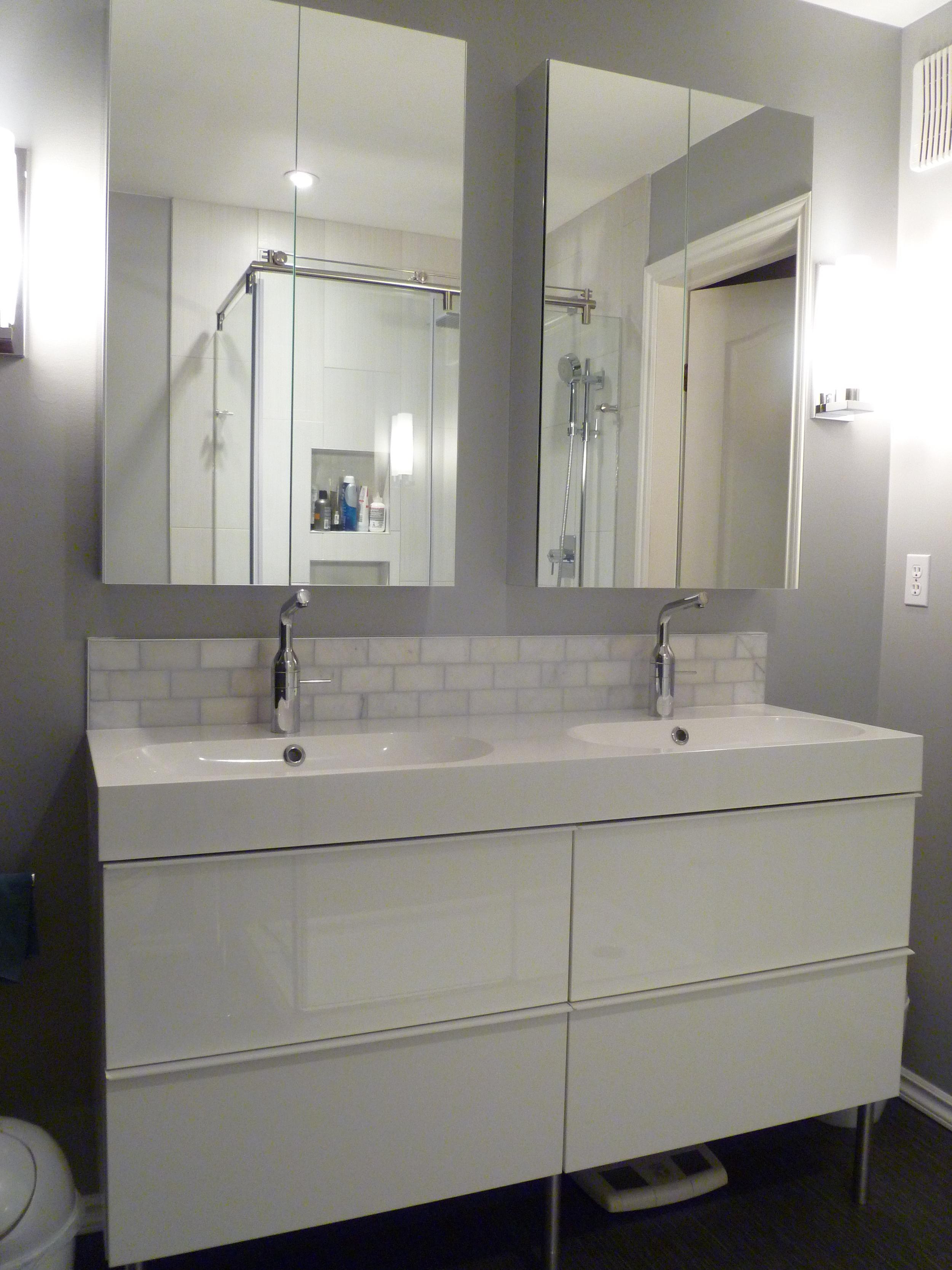 Ikea cabinet, marble backsplash, Godmorgon mirrored cabinets.