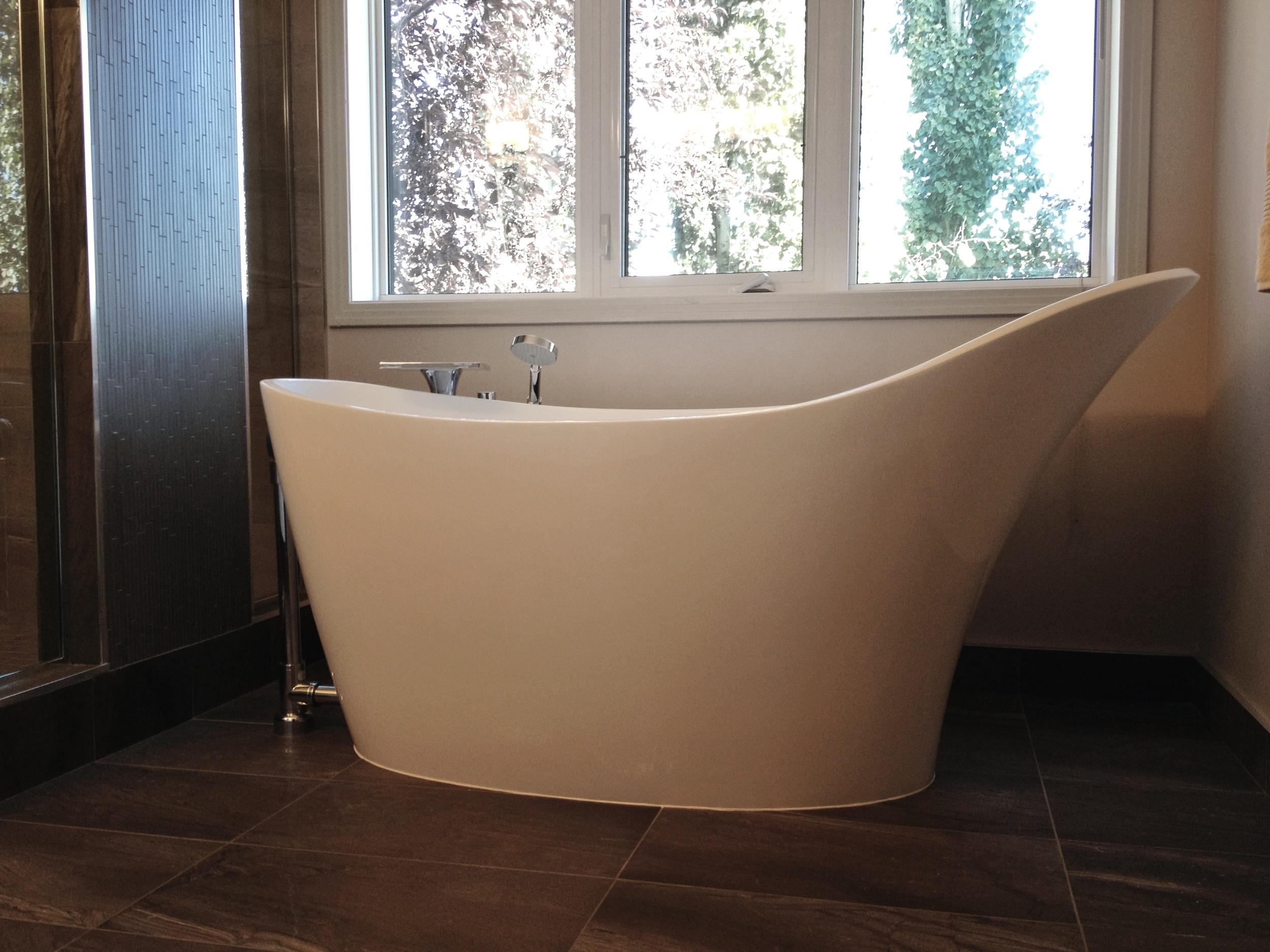 Freestanding volcanic limestone bathtub, Victoria and Albert.