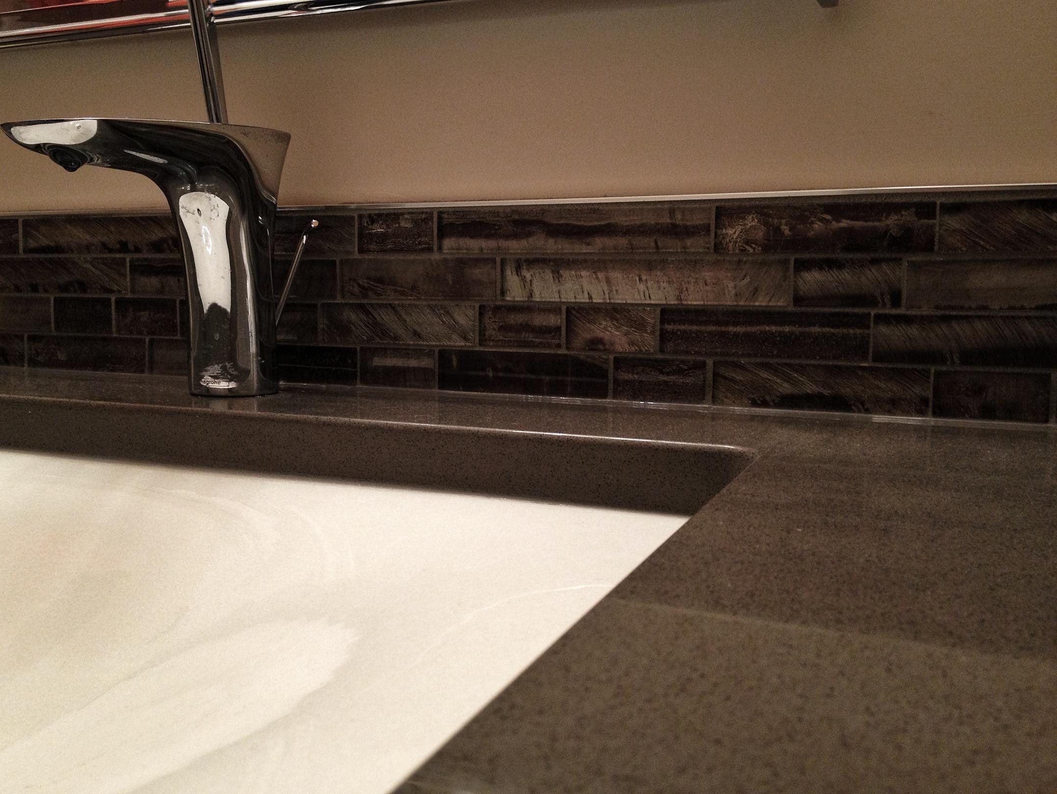 Quartz countertops, glass backsplash.