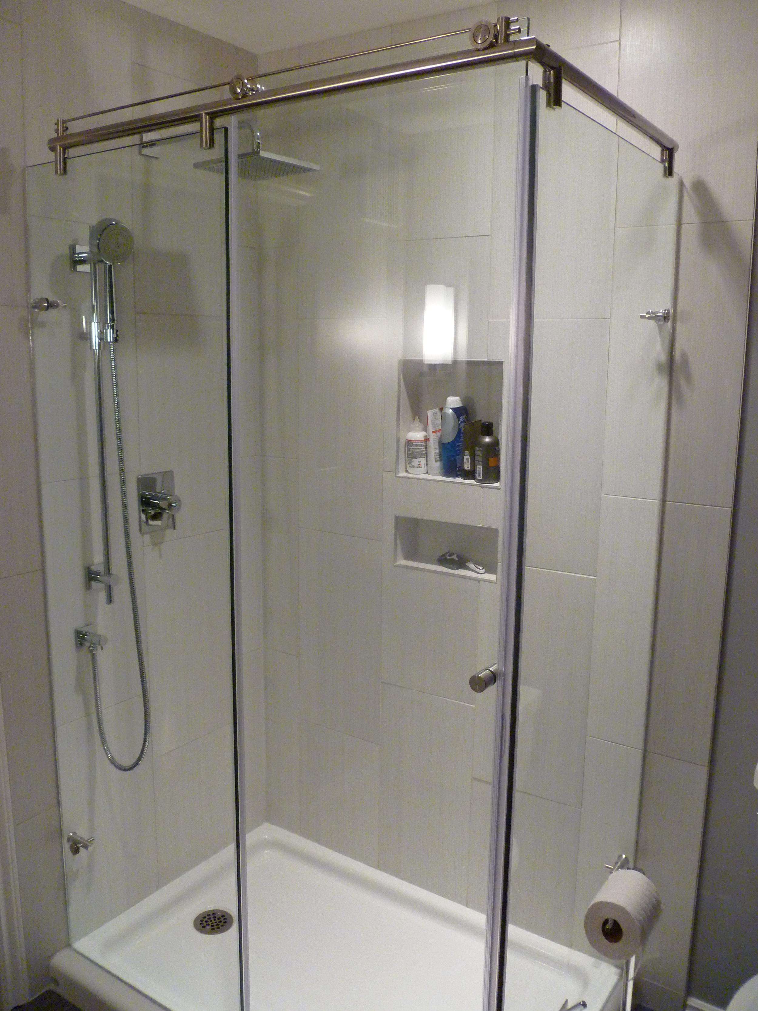 Custom Shower, porcelain shower surround, recessed shower shelves.