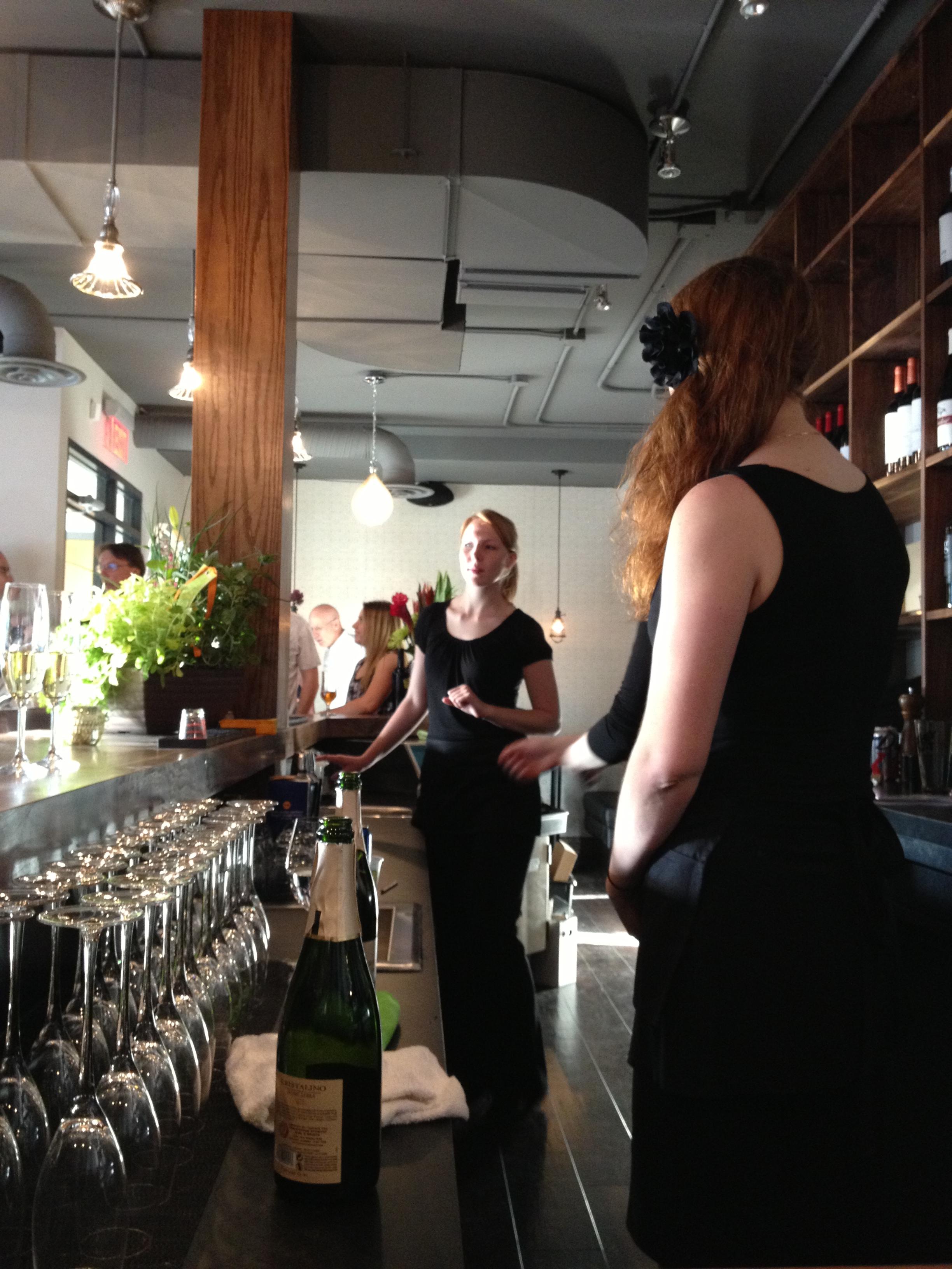 Behind the bar.
