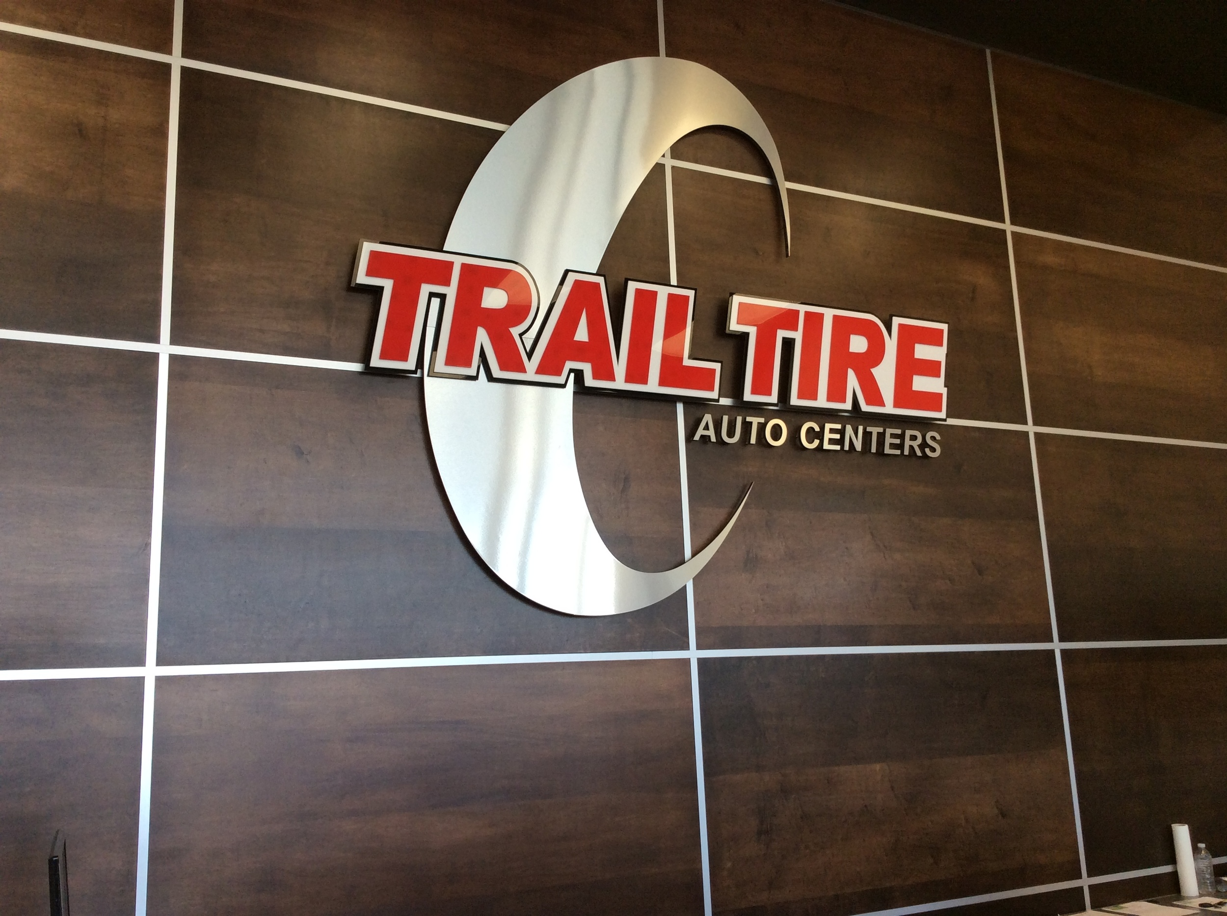 Custom wood and metal grid design, custom sign, Trail Tire Kingsway.