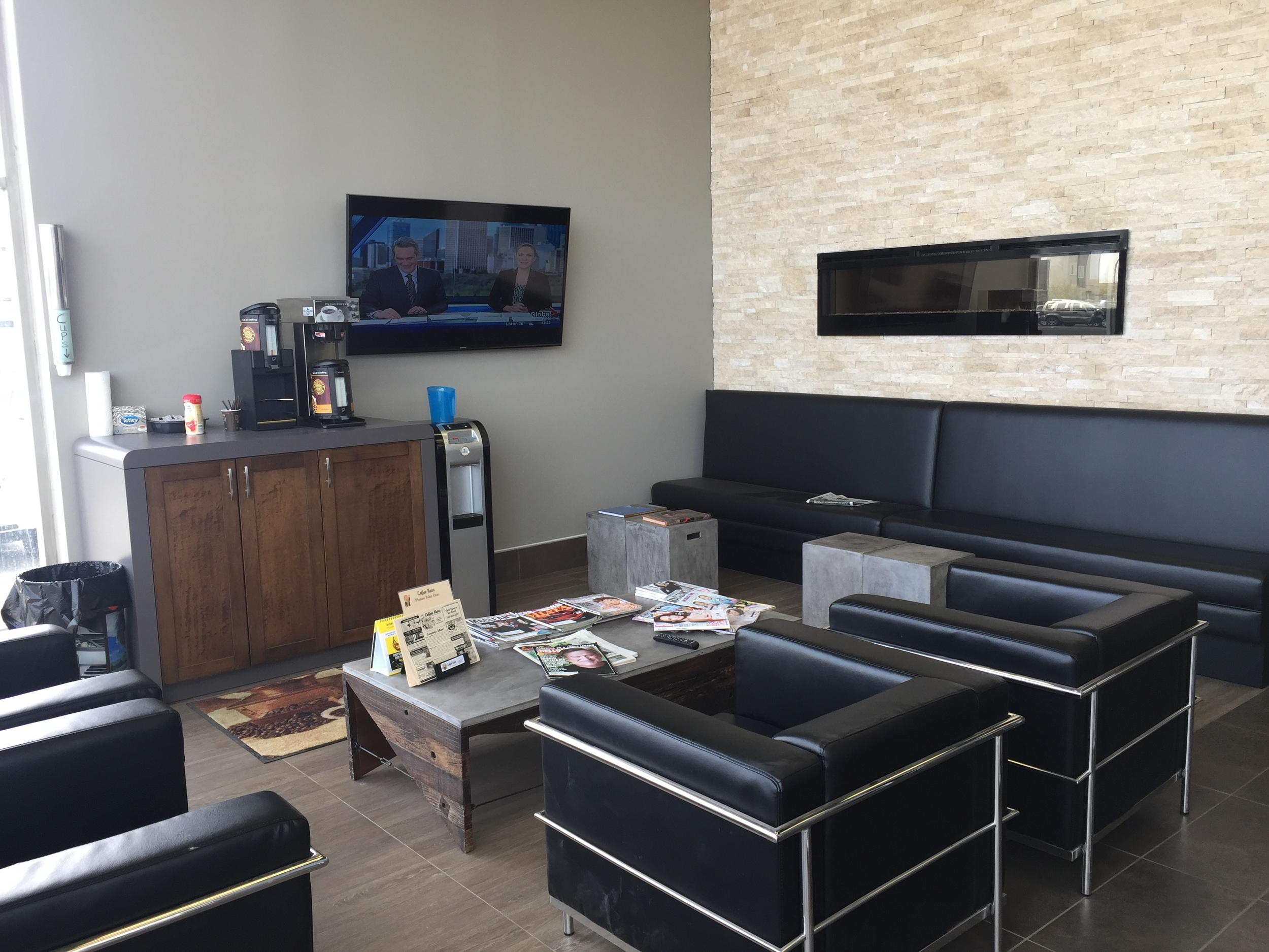Client waiting area, custom fireplace and bench seat.