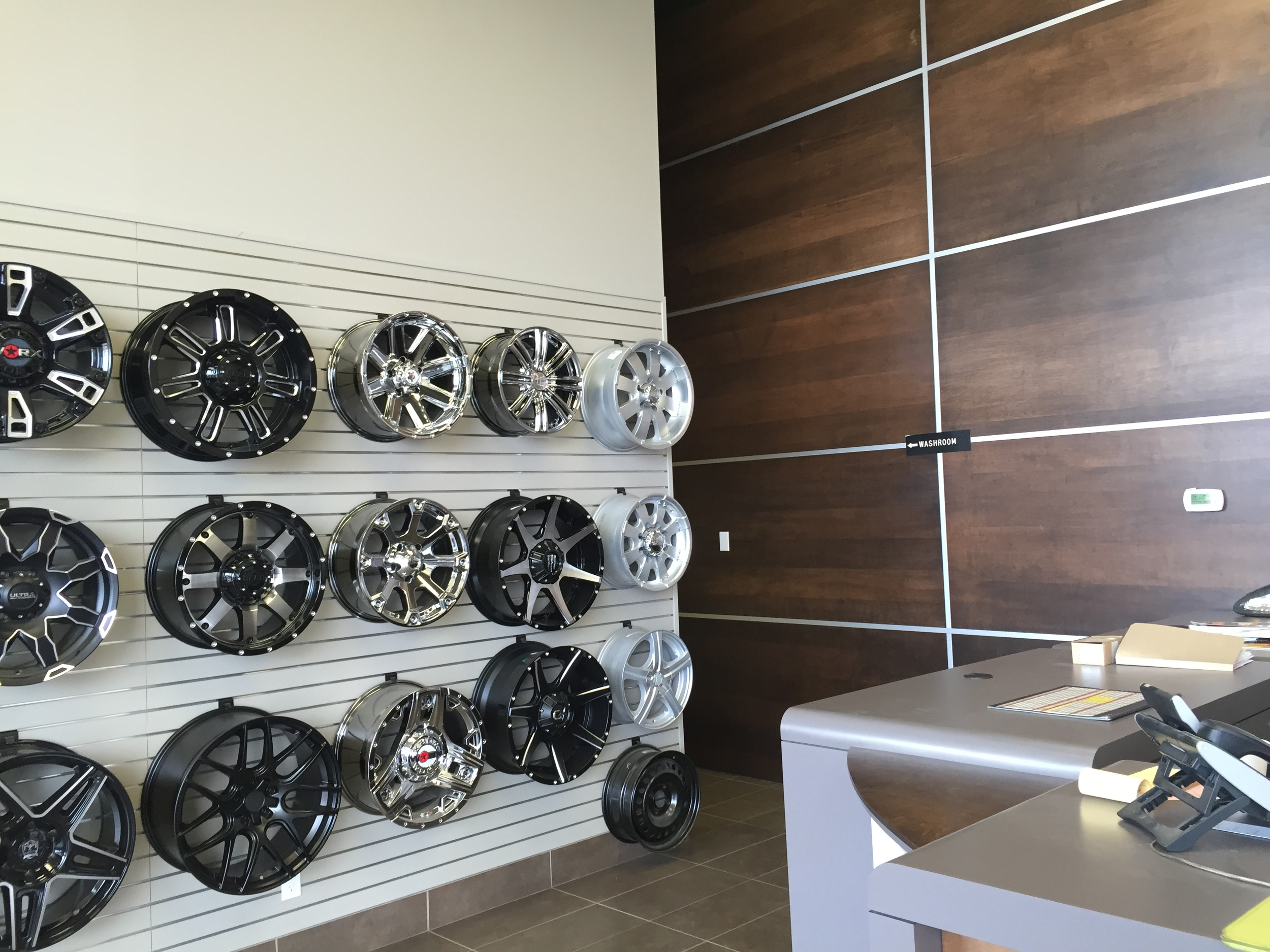 Merchandising wall and custom wood and metal feature wall.