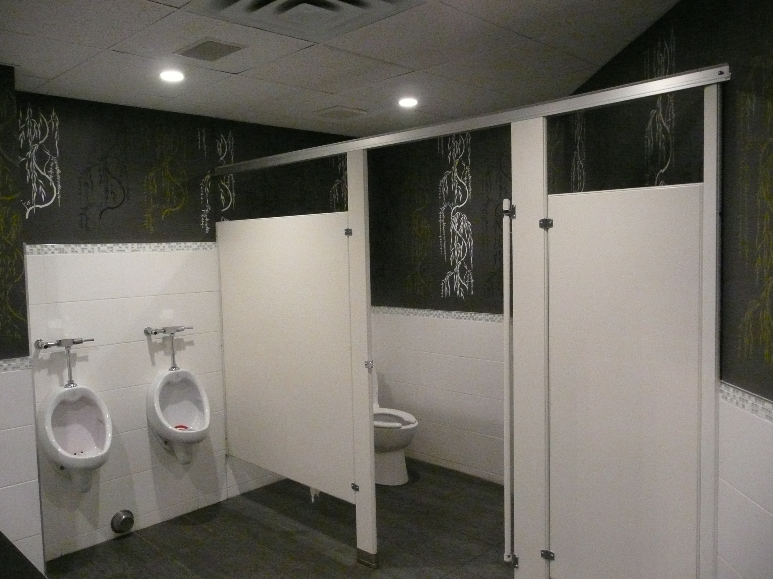 Custom stencilled walls, ceramic and stone and glass feature.