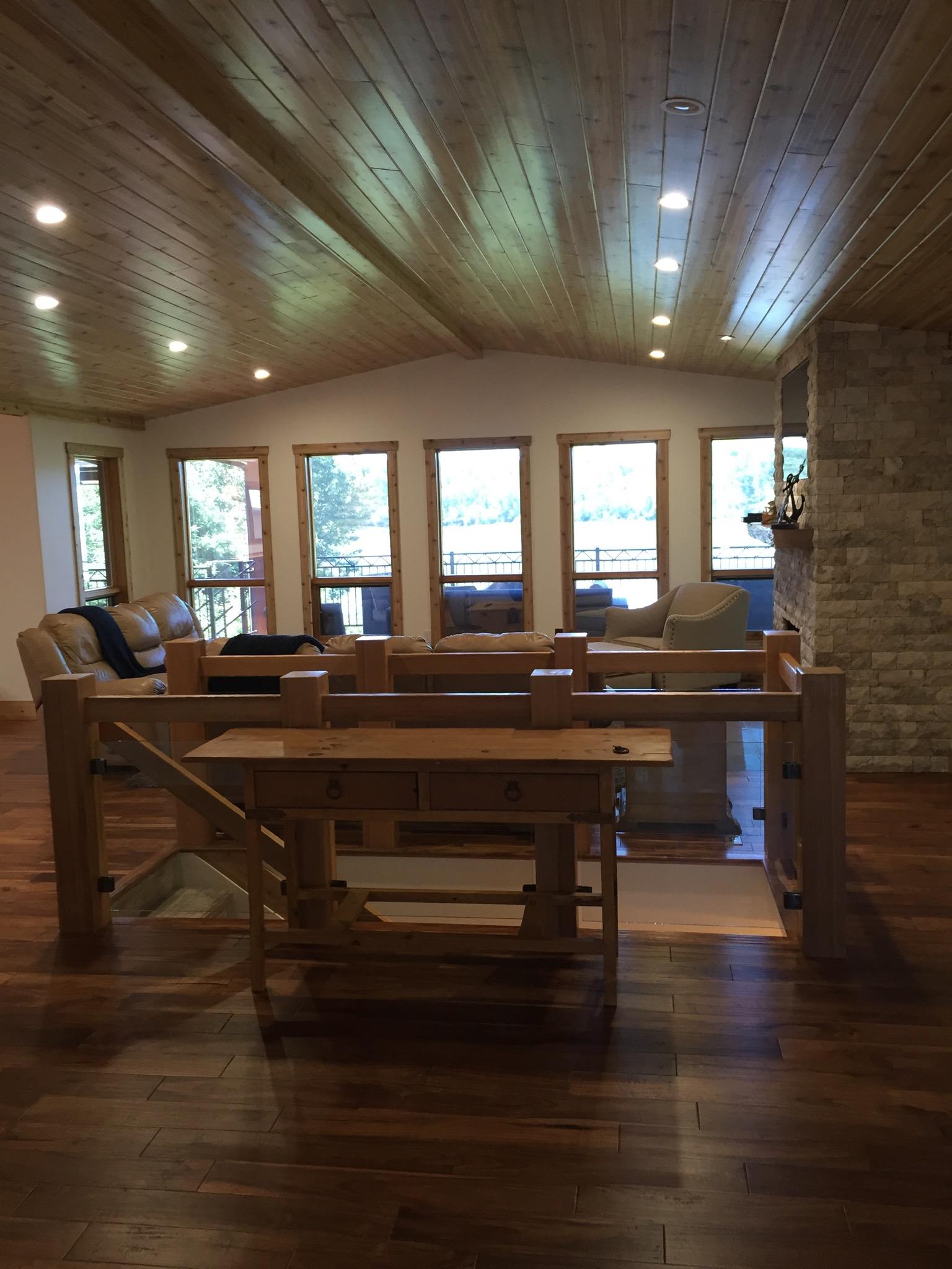 Open concept stair surround cedar posts and glass,cedar ceiling.