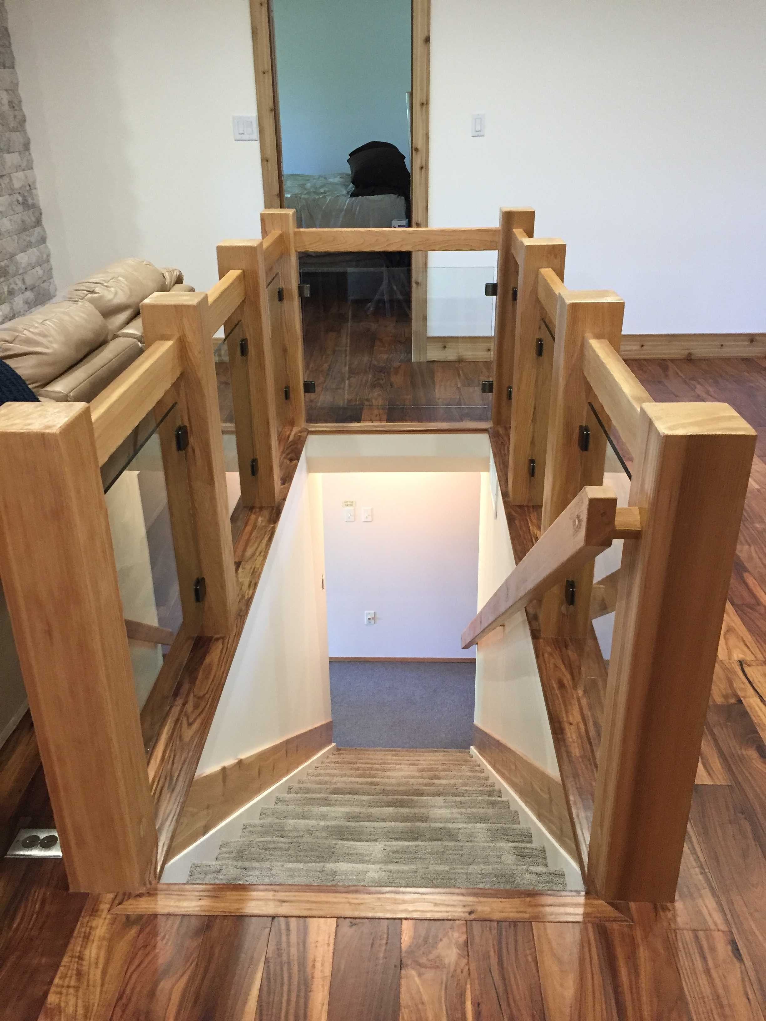 Cedar beam and glass stair surround, Kevin Clow.