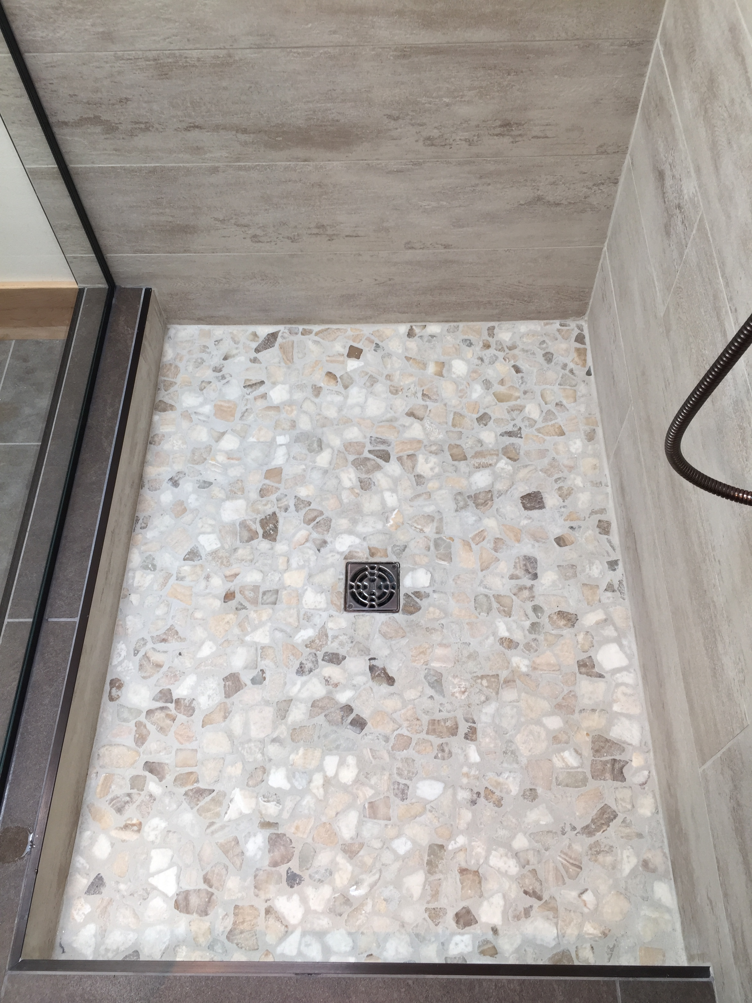 Custom shower, pebble floor.